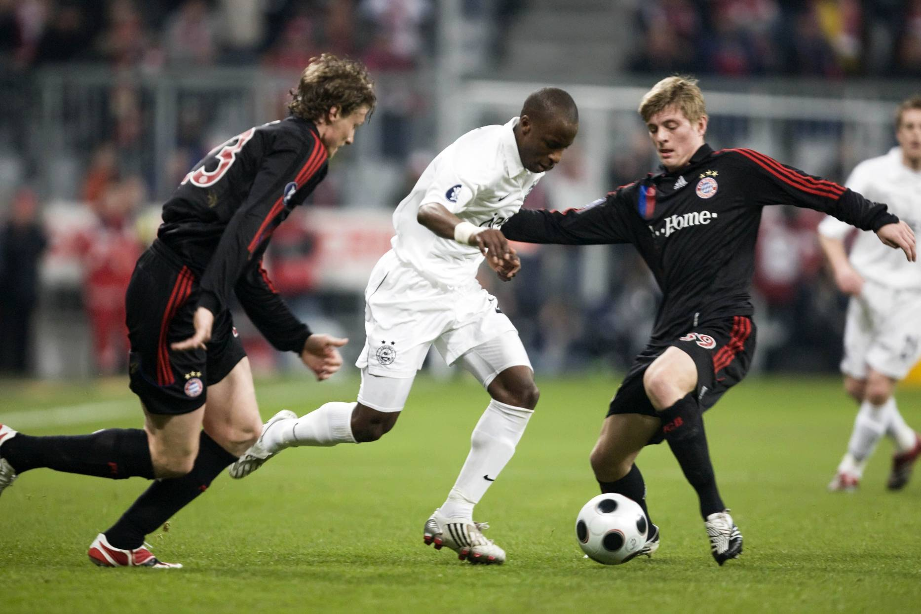 Bayern Munich duo Marcell Jansen (left) and Toni Kroos (right) close in on Sone Aluko