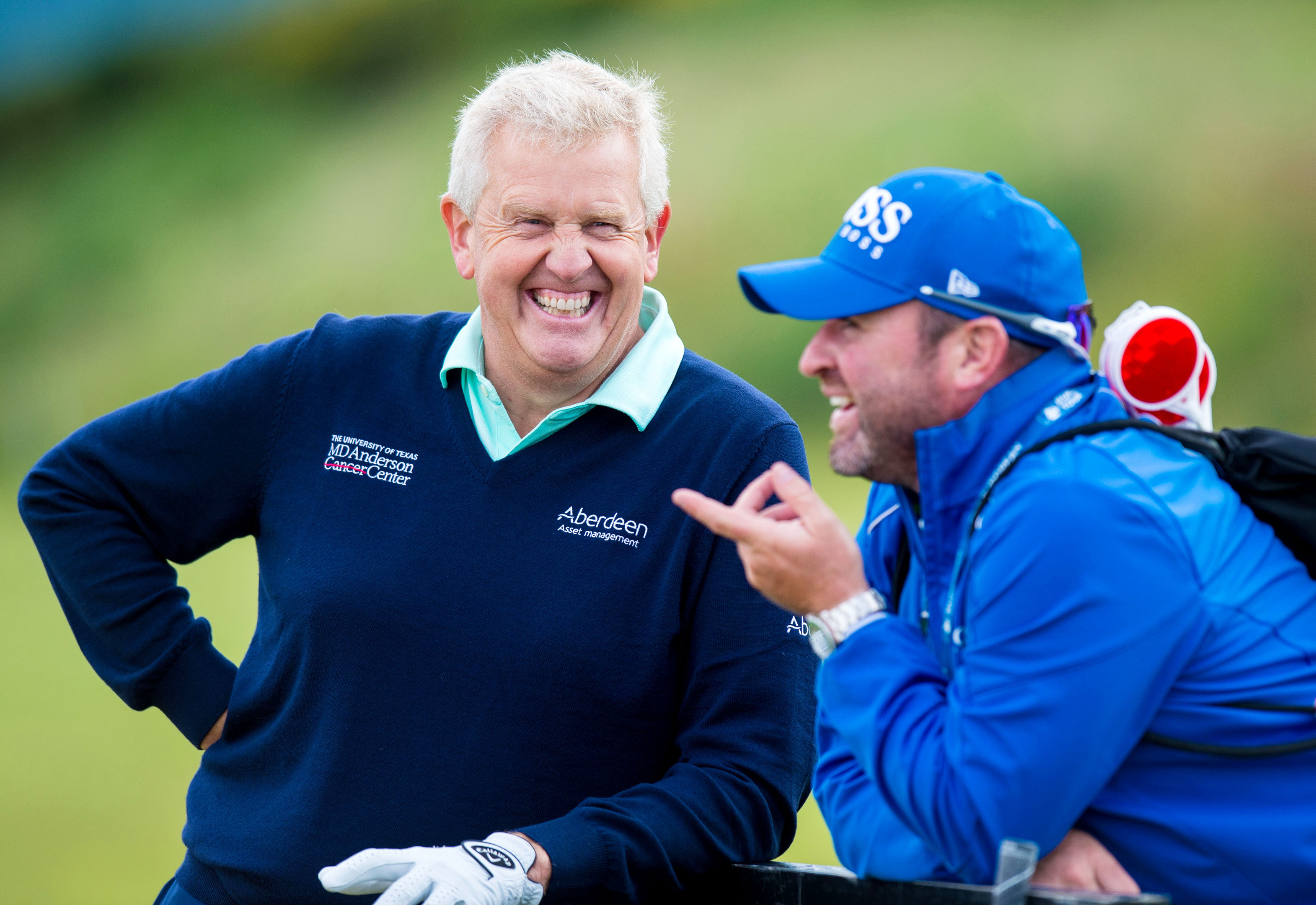 INSIDE INFO:  Colin Montgomerie shares a joke with Martin Kaymer's caddie Craig Connolly at Castle Stuart.