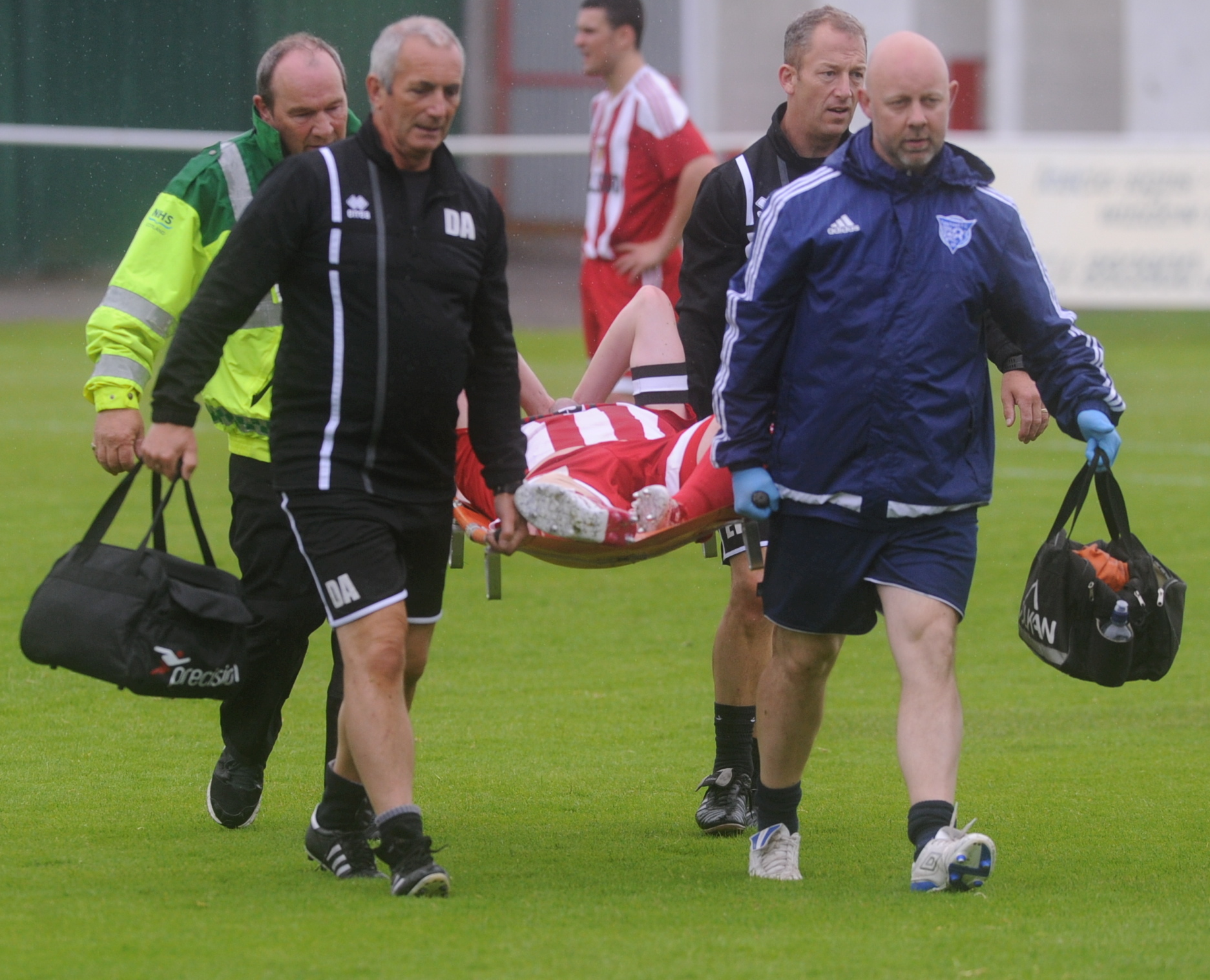 Formartine captain Craig McKeown is taken off the pitch with a suspected serious knee injury.