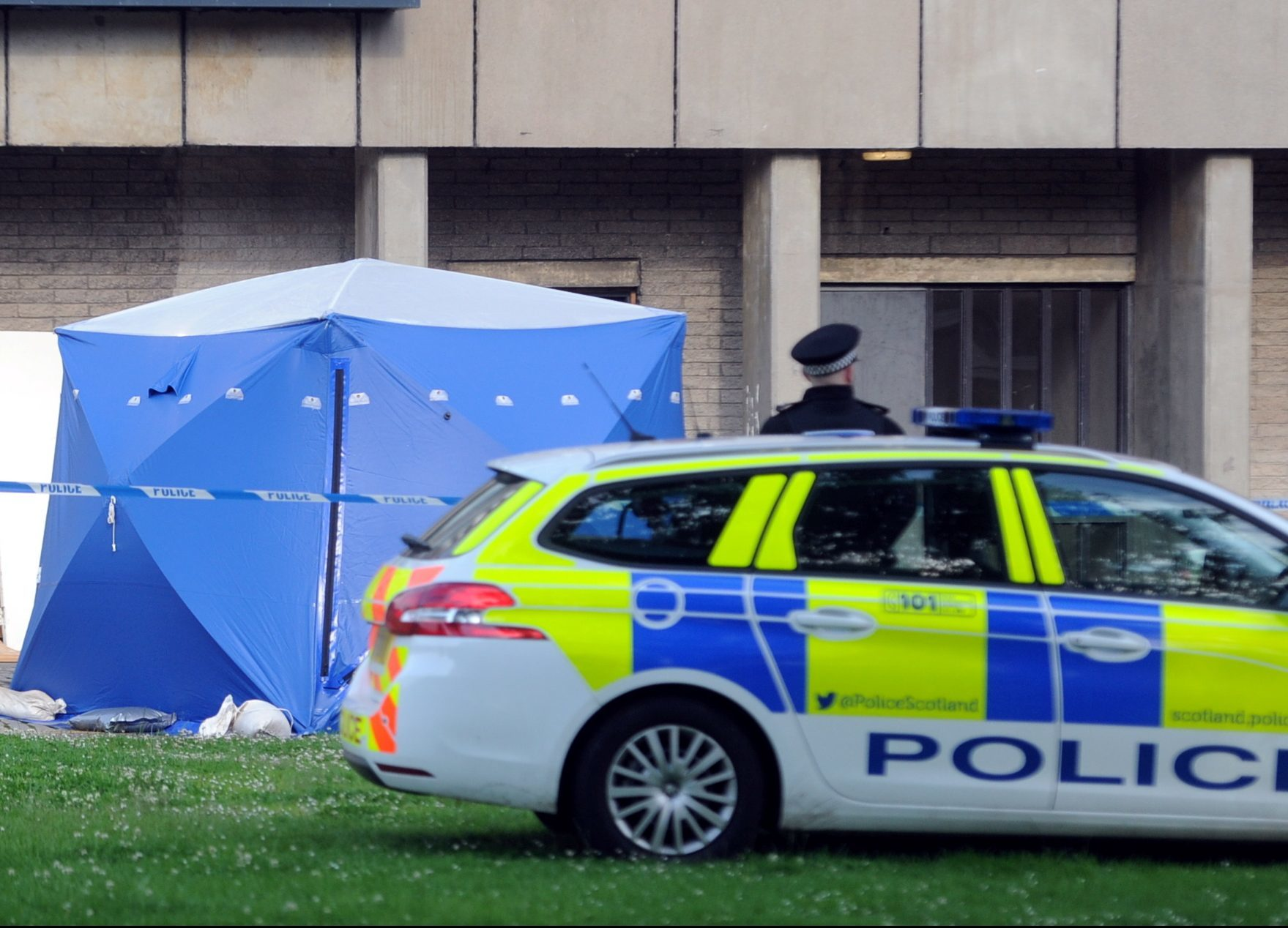 Police on the scene at Donside Court, where three people died