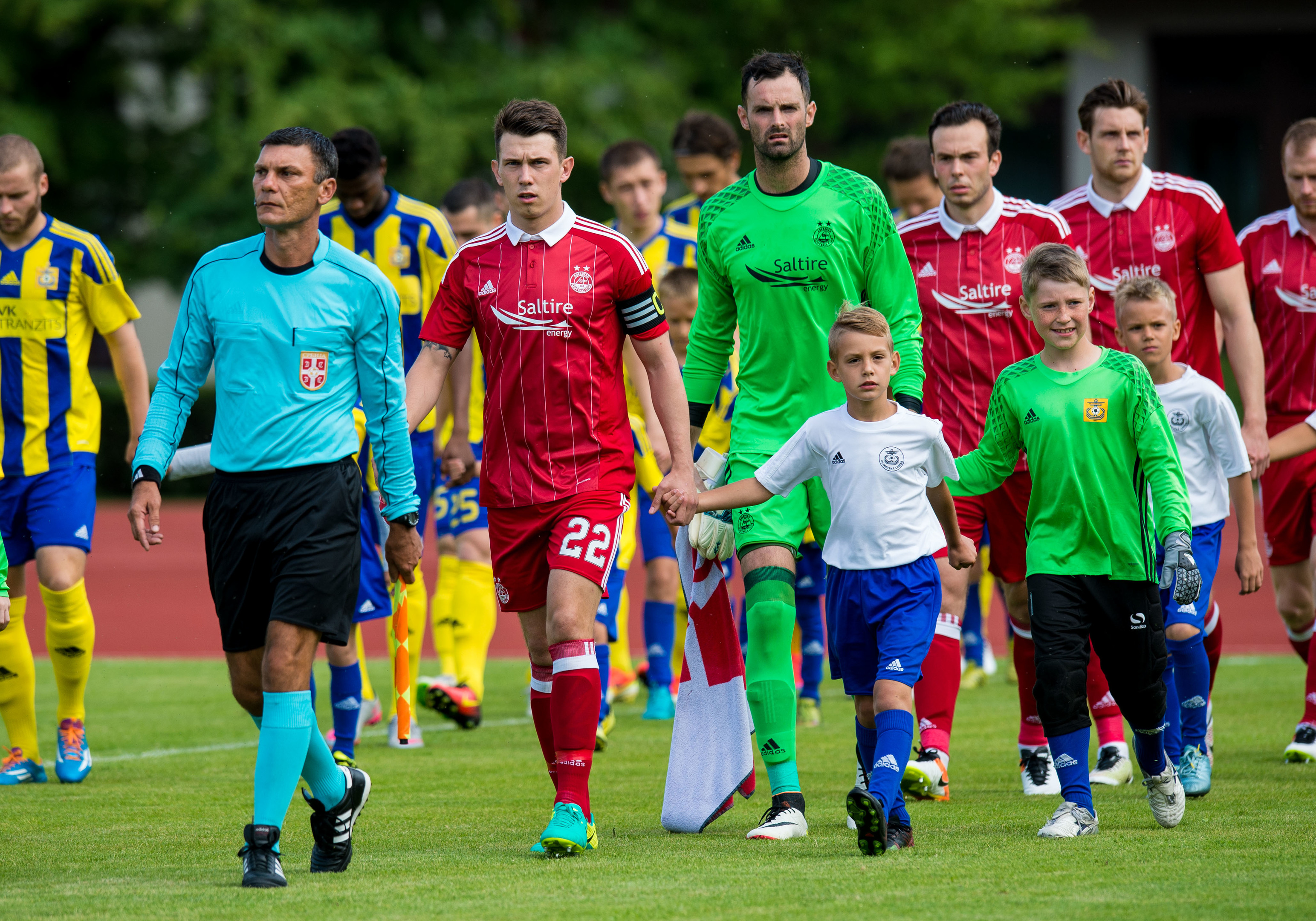 Skipper Ryan Jack leads Aberdeen on to the pitch at Ventspils.