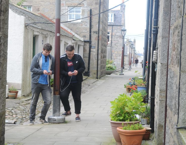 Players Kieran Mackenzie, left, and Calum Sinclair hunt for Pokemon in Fittie.