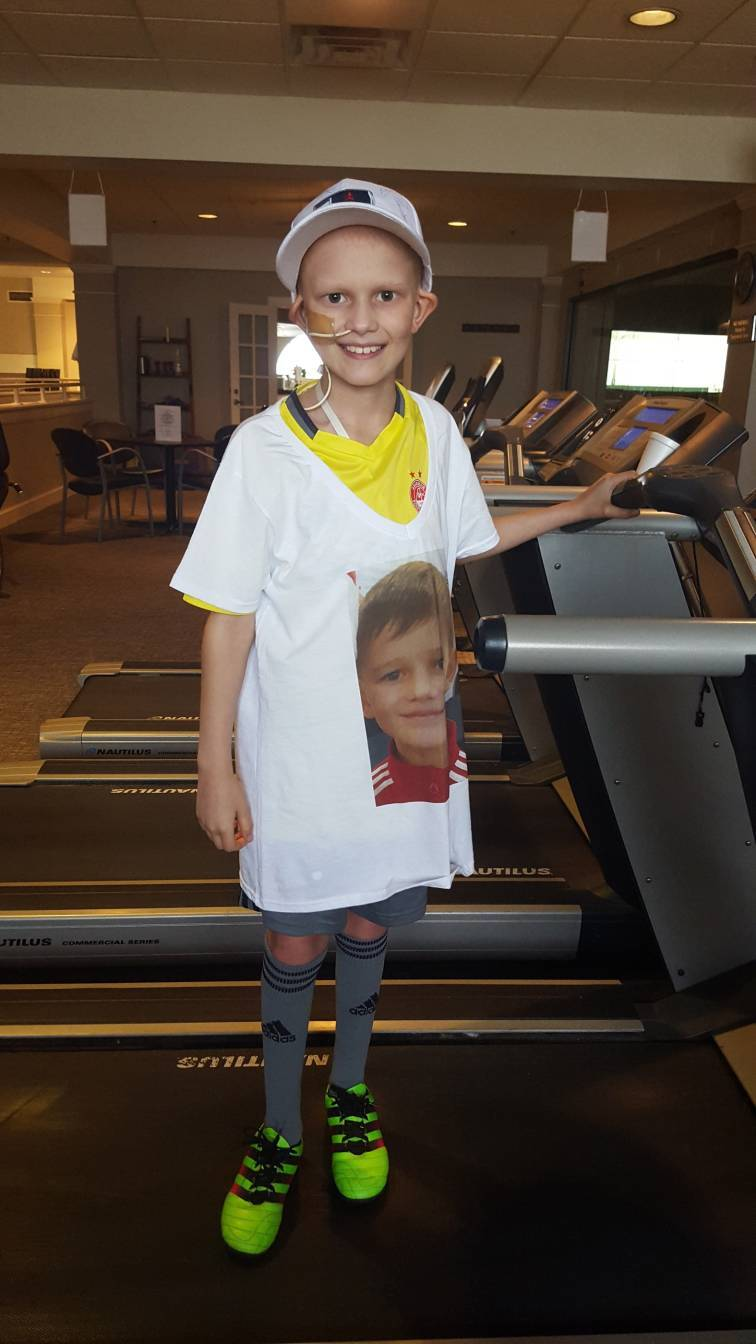 Finlay doing his bit for Race For Life on the treadmill.