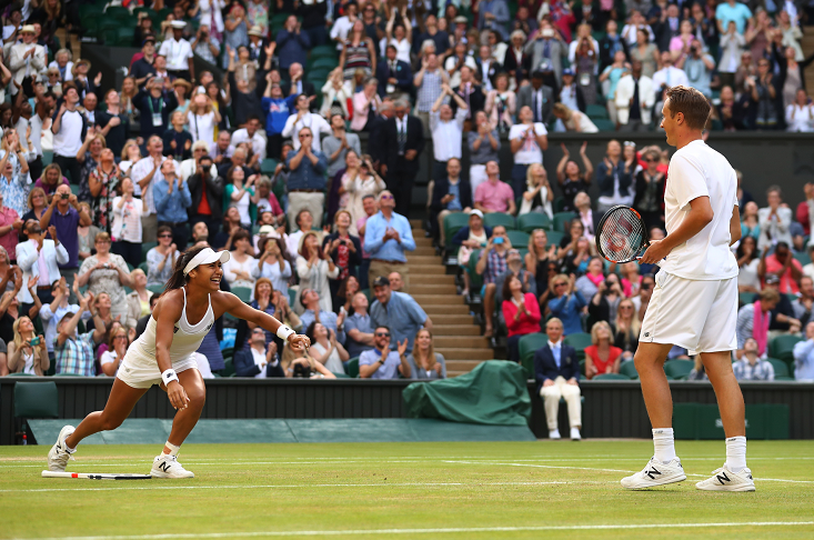 Heather Watson rushes to celebrate with doubles partner Henri Kontinen