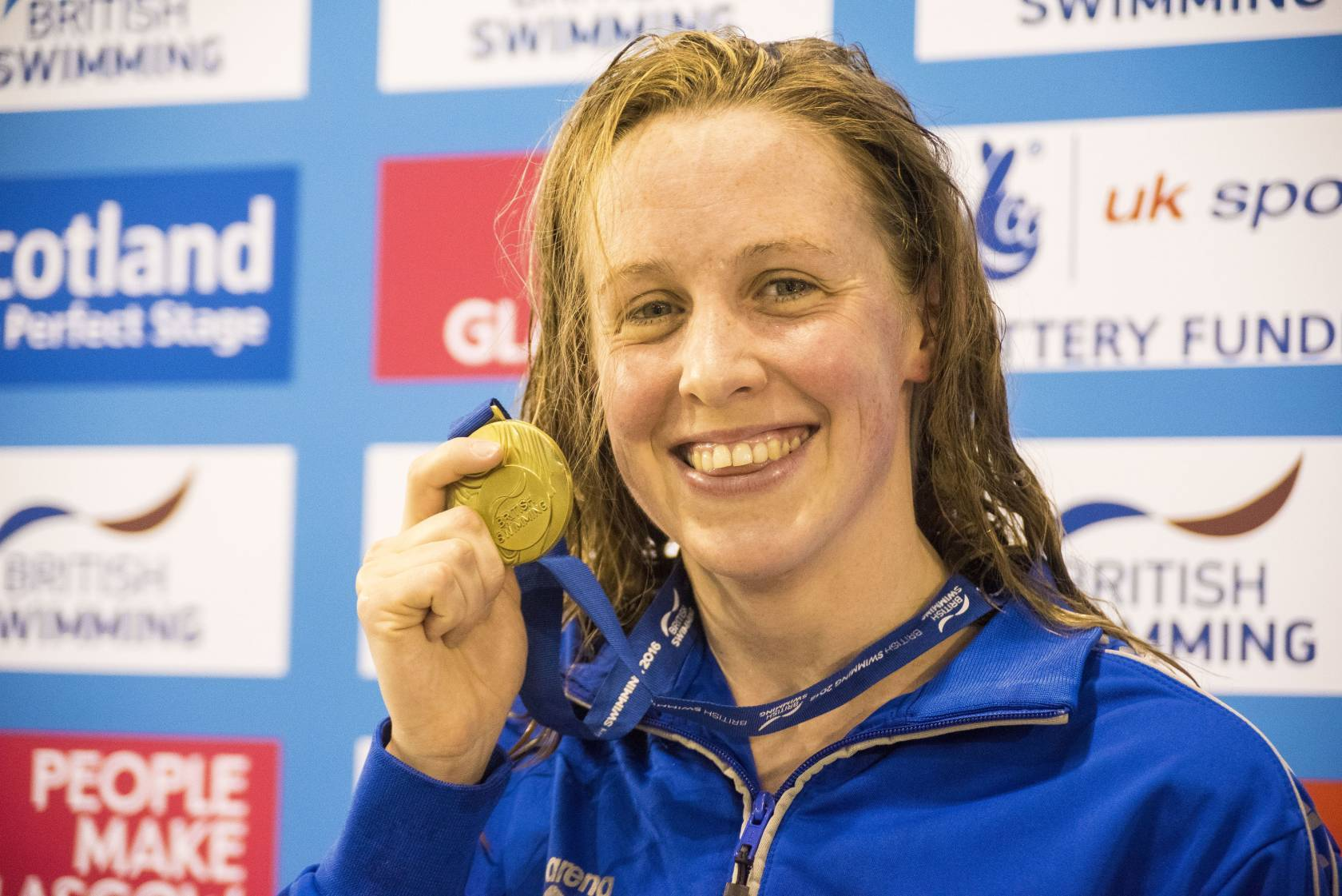 Hannah Miley celebrates with the gold medal after winning the Women's Open 400m IM during day one of the British Swimming Championships at Tollcross International Swimming Centre.