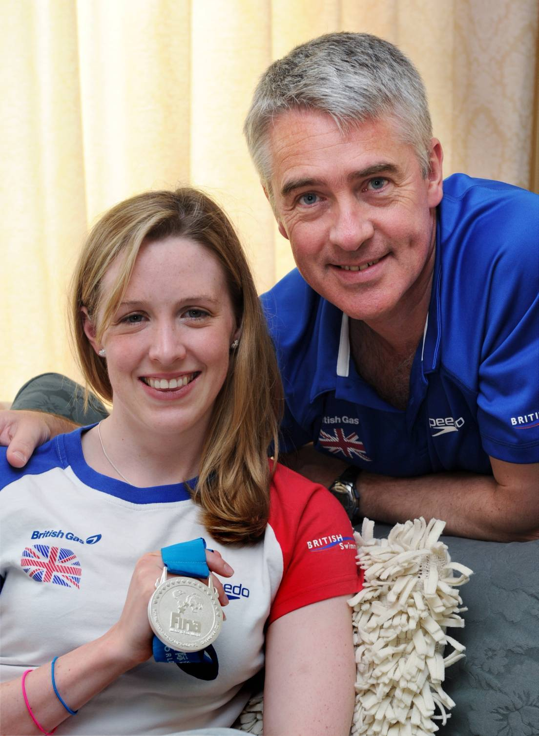 Hannah Miley at home in Inverurie with her silver medal from Shanghai and her dad Patrick.