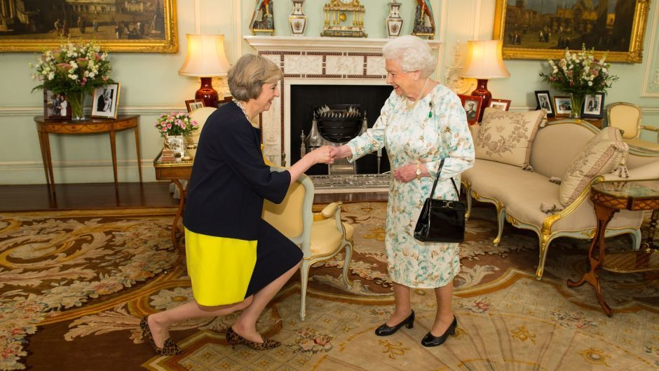 The Queen welcomes Prime Minister Theresa May at Buckingham Palace.