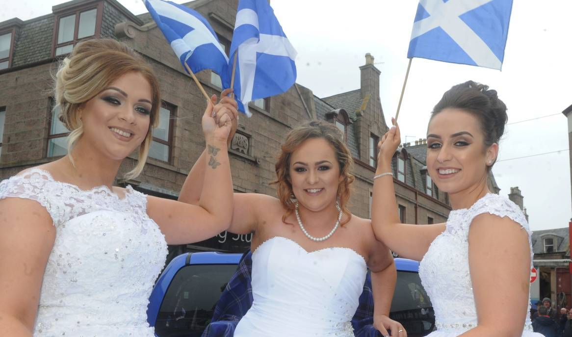 Buchan Queen Katie Woods, centre with Princess's, Sinead O'Brien left and Shelley McWilliam.