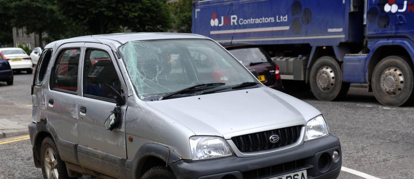 A silver Daihatsu Terios was involved in the crash.