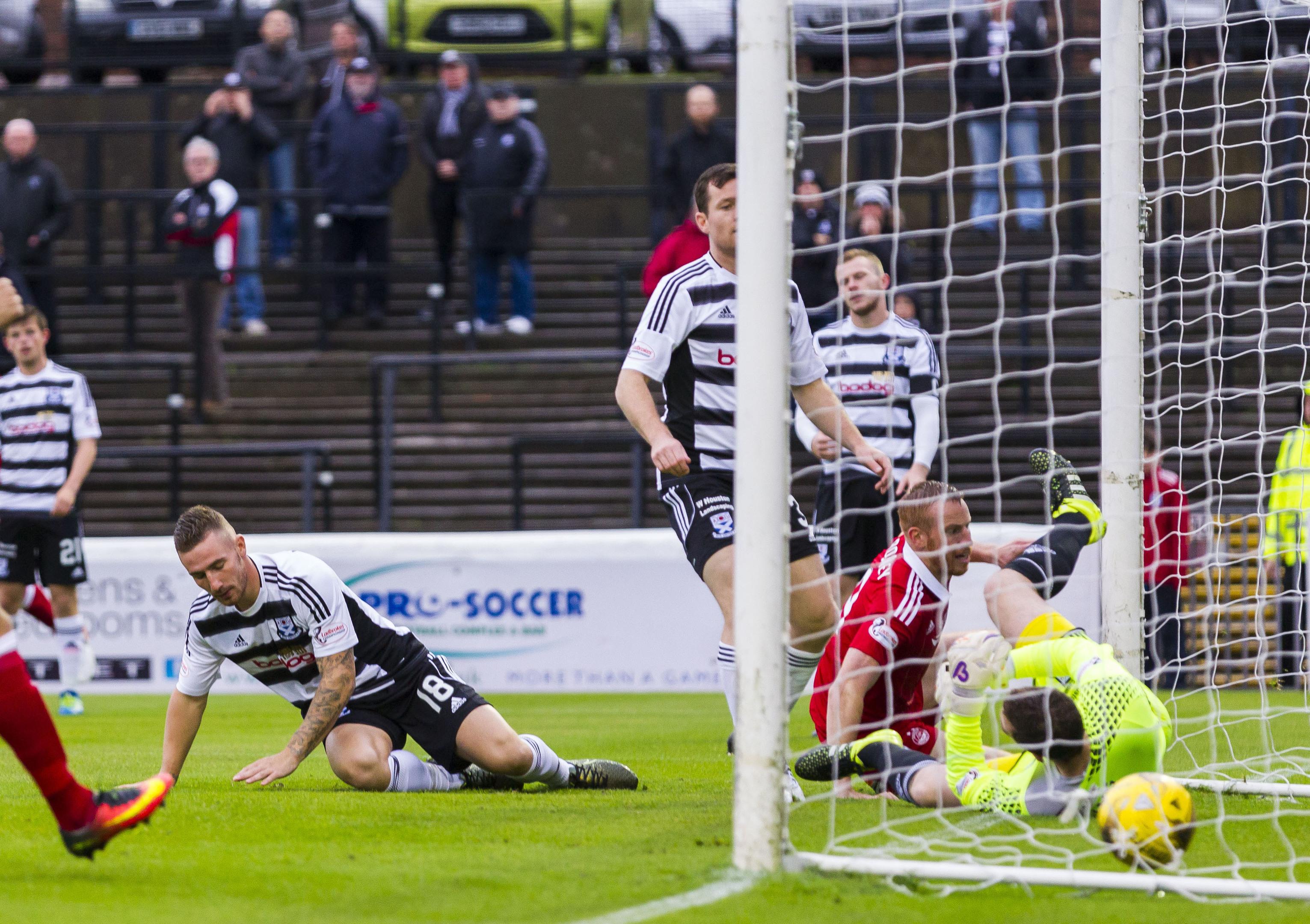 Ayr's Daryll Meggatt scores an own goal putting Aberdeen into the lead.