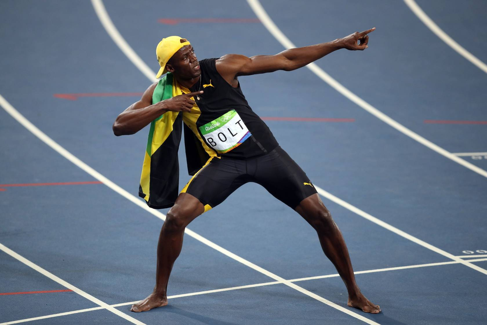Jamaica's Usain Bolt celebrates winning the men's 100m final at the Olympics Stadium on the ninth day of the Rio Olympics Games, Brazil.