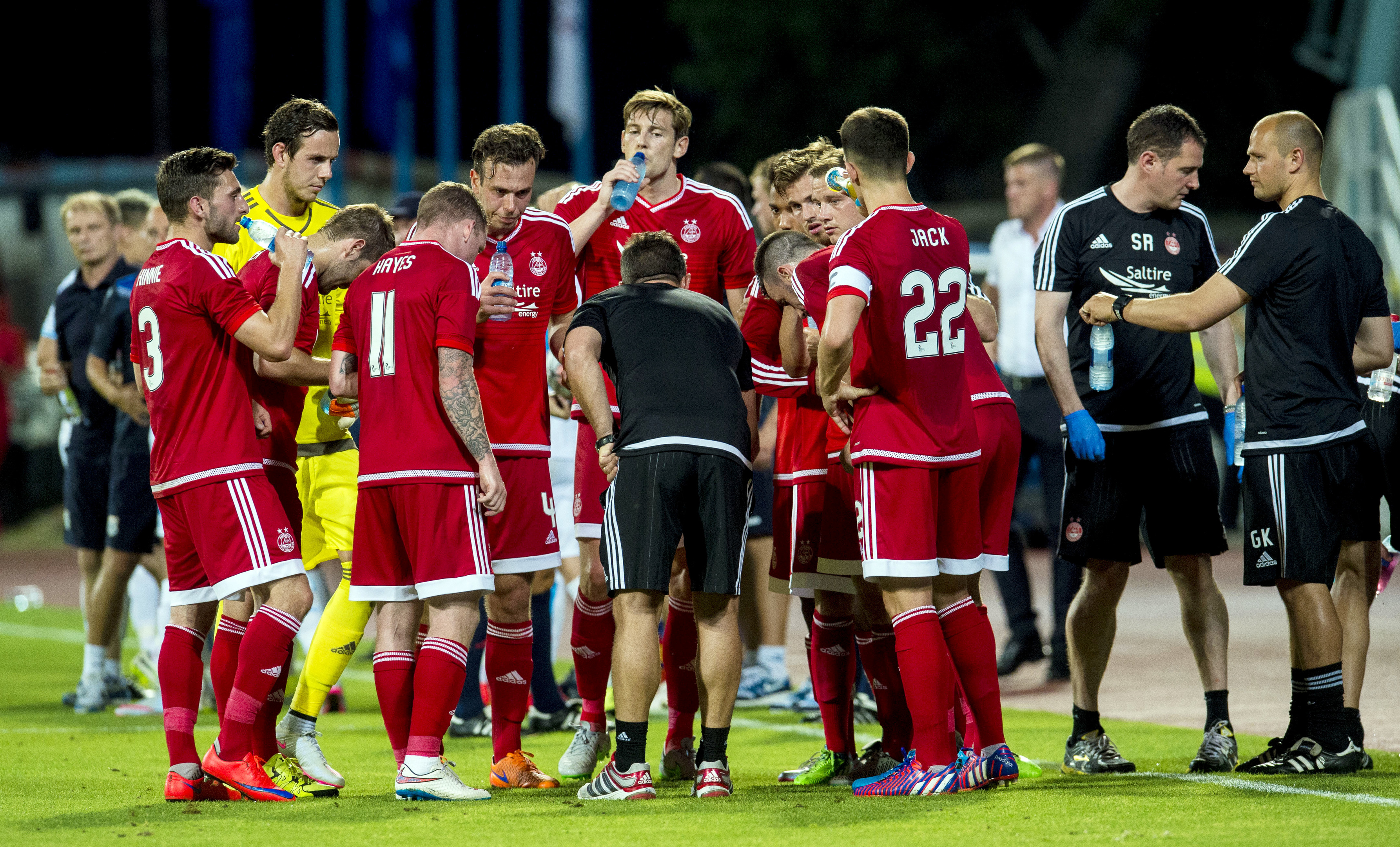 Cooling off:  The Aberdeen squad enjoy a water break during their match against Rijeka.