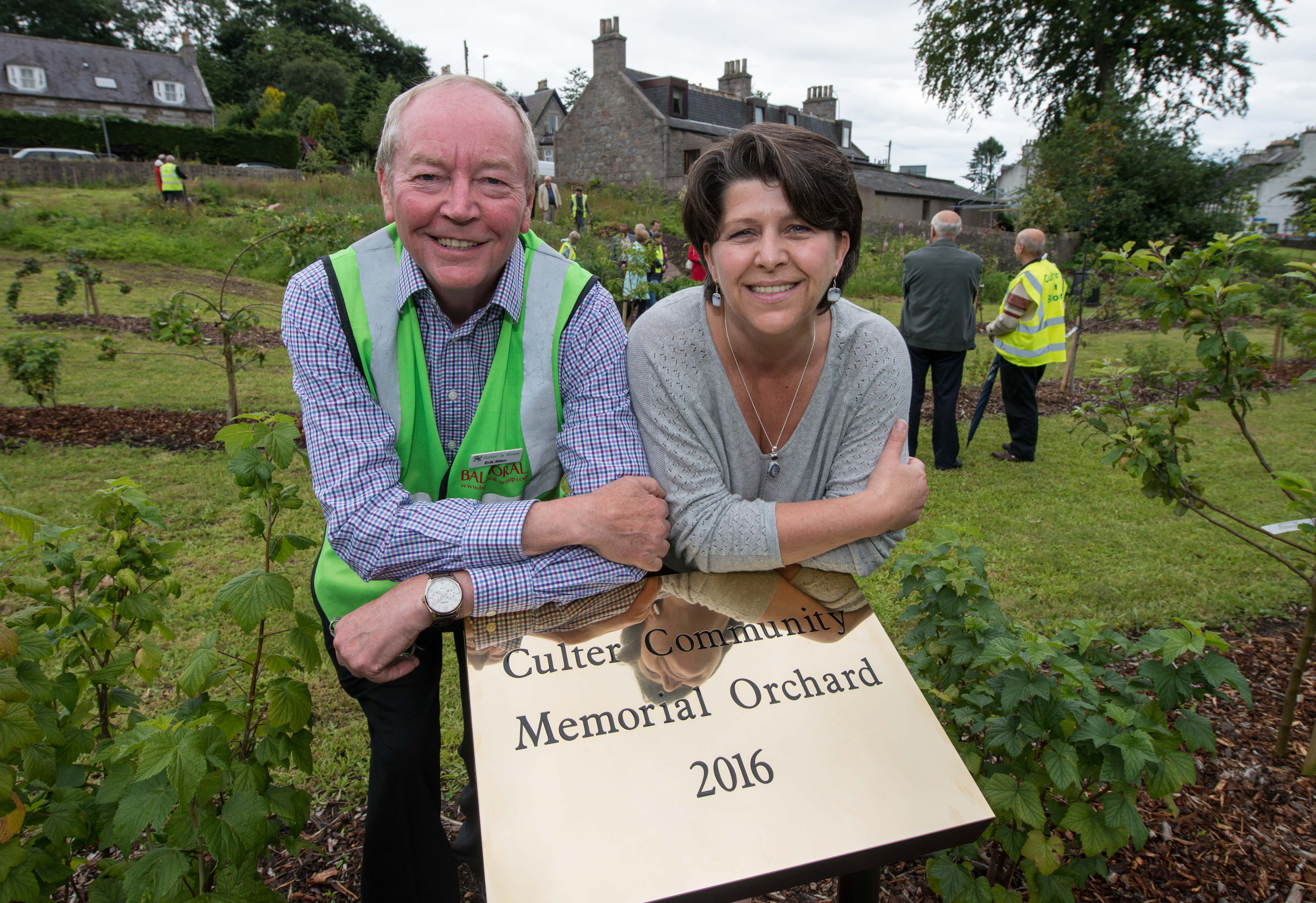 Launch:  Erik Stein, of Culter in Bloom, left, with Aberdeen City Council depute leader Marie Boulton at the official opening of the new orchard.