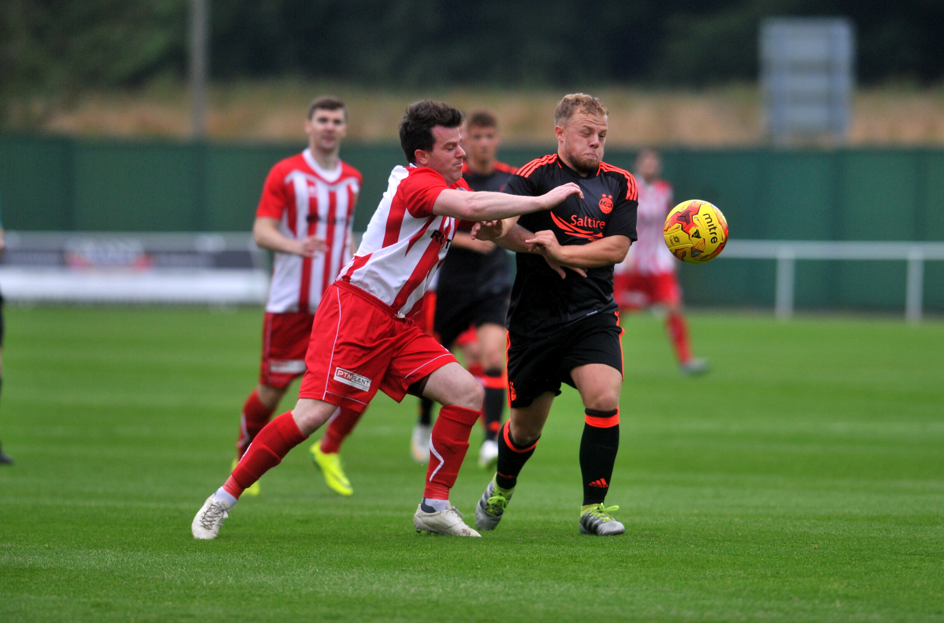 Formartine's Conor Gethins, left,  and Aberdeen's Dylan Thomas battle it out.