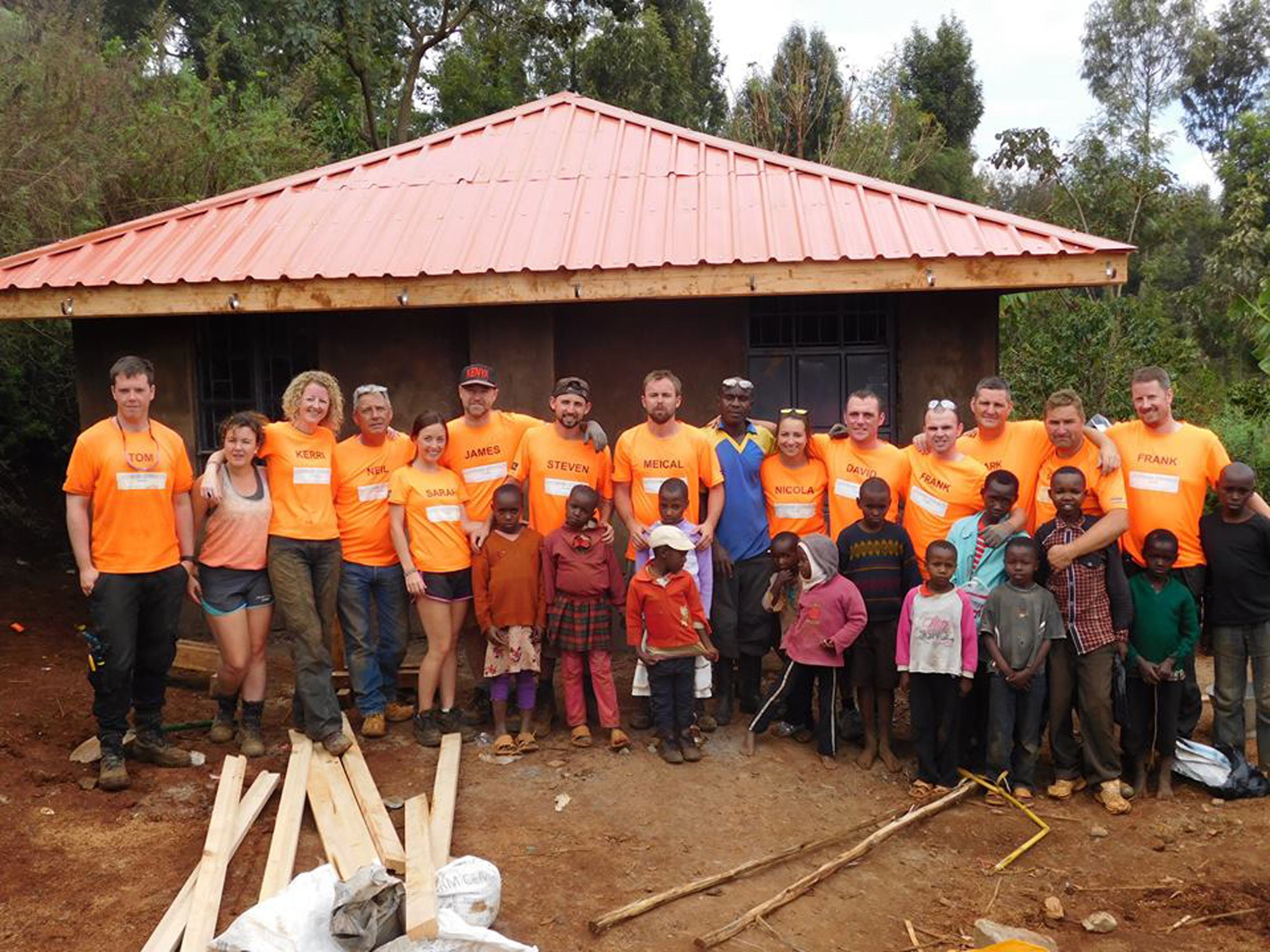 Nicola Henderson with volunteers and some of those they helped in Kenya.