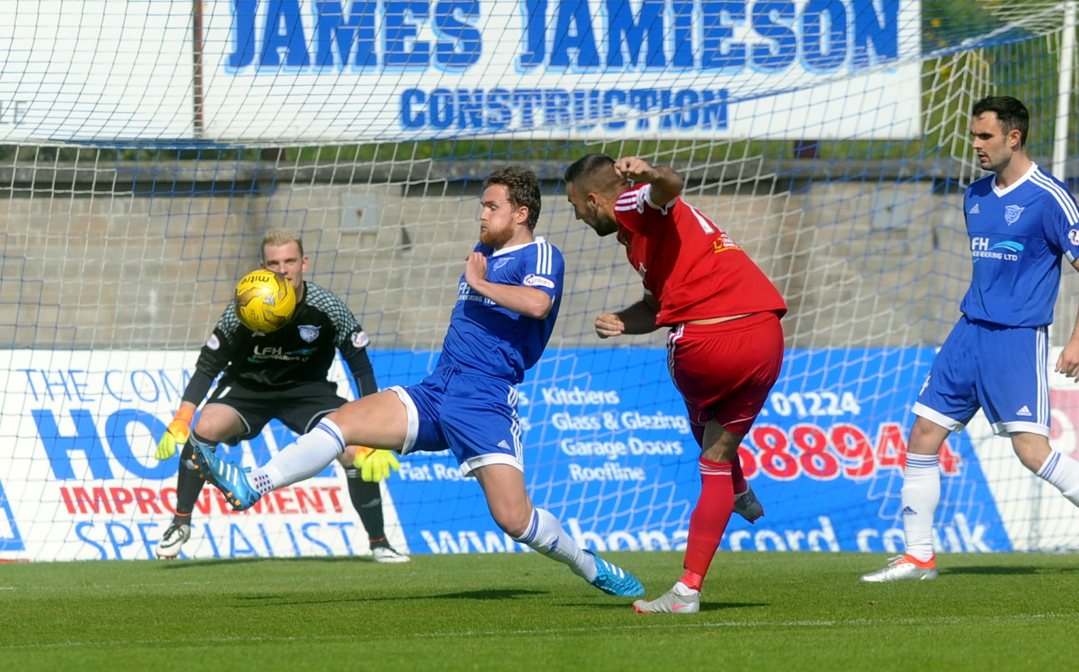 Peterhead's Scott Rumsby deflects a shot by Albion's Scott McBride.  picture by chris sumner