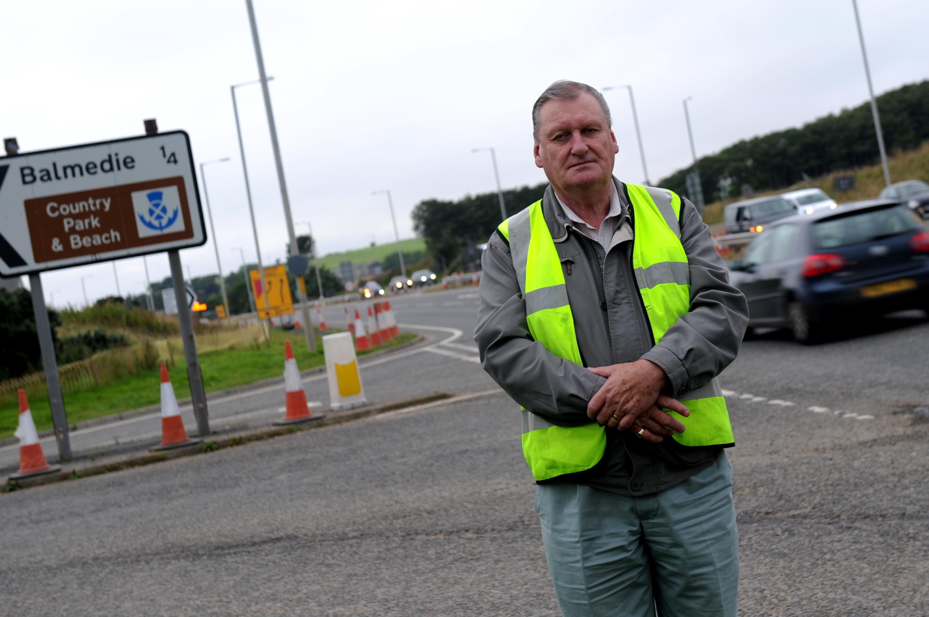 Councillor Allan Hendry on the A90 near Balmedie.