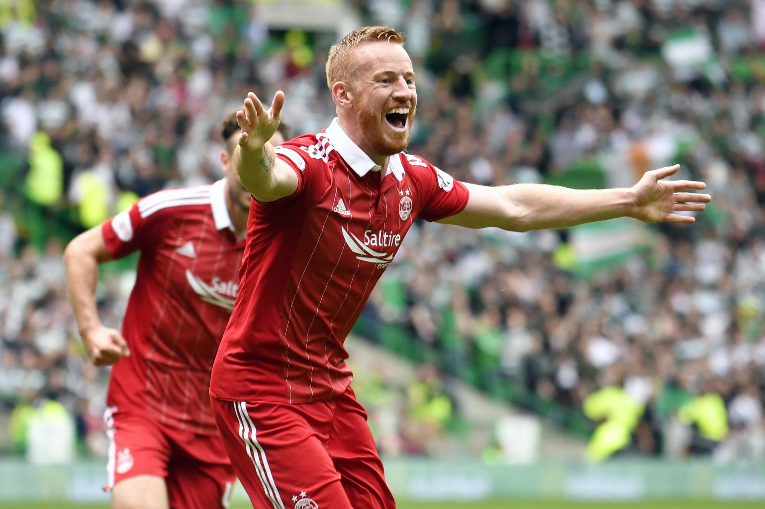 Adam Rooney celebrates his equaliser against Celtic.