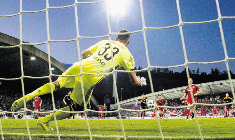 Adam Rooney's first-half penalty was saved.
