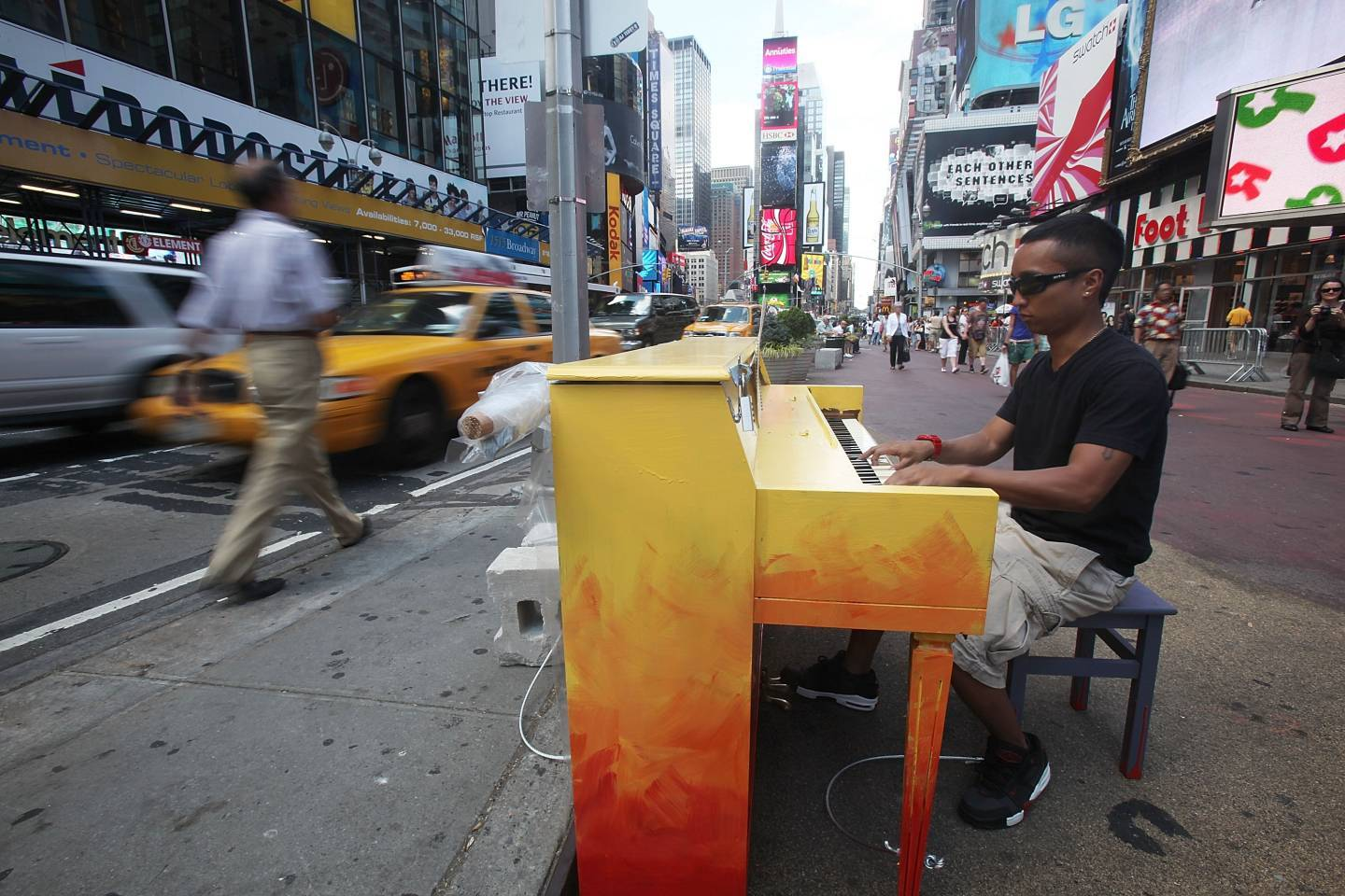 "Allan Decipulo play a piano in Times Square as part of the ""Play Me, I?m Yours"" public art installation"