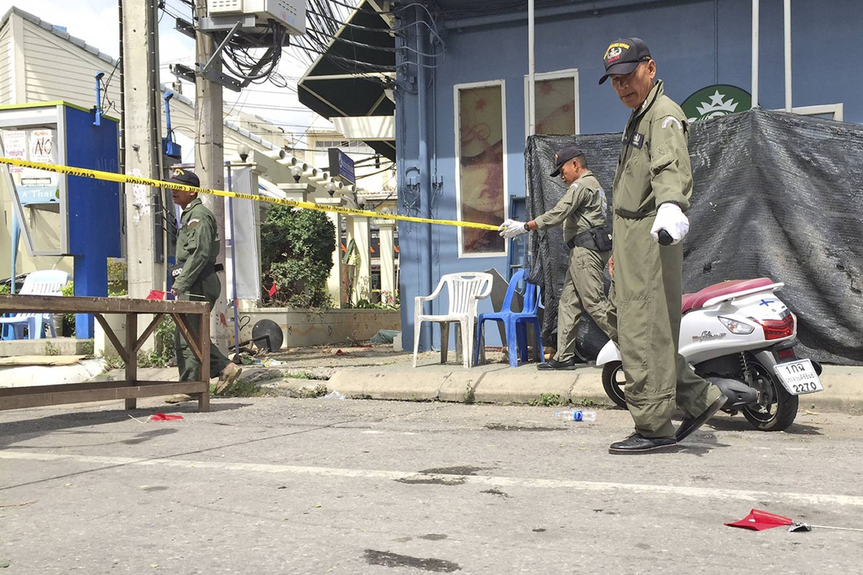 Investigators work at the scene of an explosion in the resort town of Hua Hin.