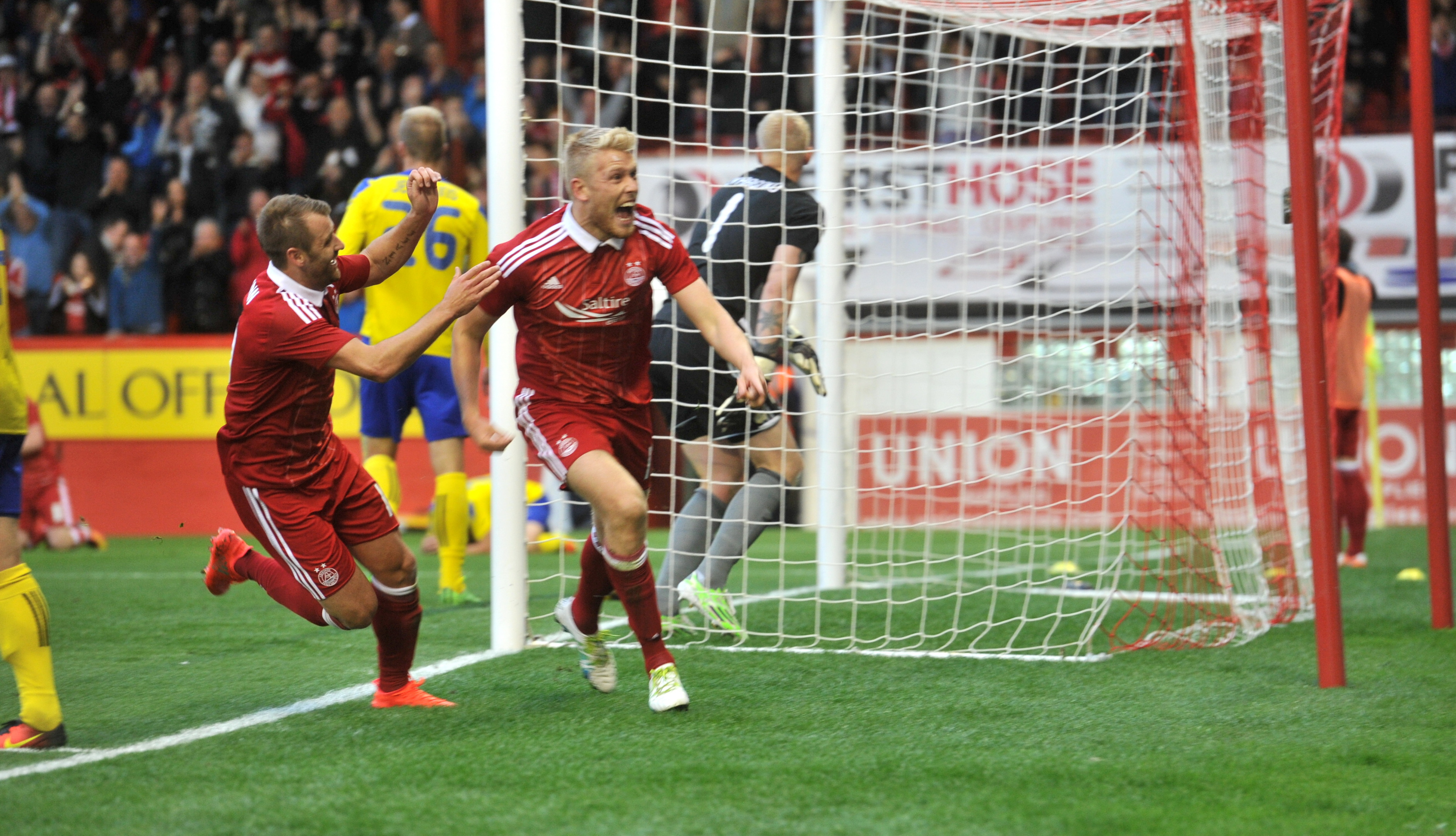 Striker Jayden Stockley scoring against Ventspils in the Europa League - the last European home game where the Dons didn't concede.