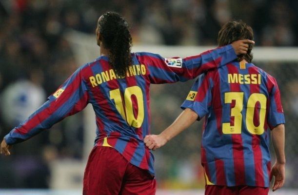 Ronaldinho celebrates with Lionel Messi in 2005.