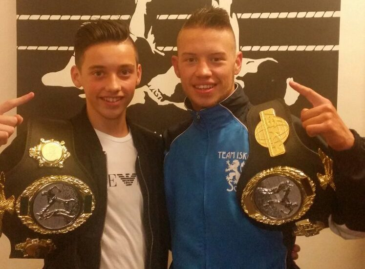 Jamie, left, and Dean  Sutherland with their latest kickboxing belts.