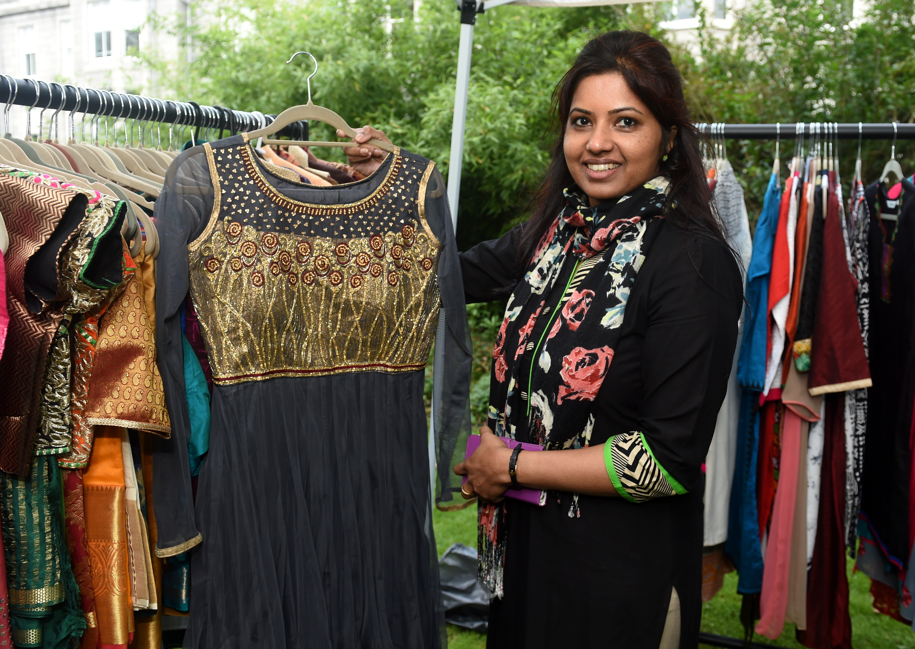 Lin Mathew shows off a black and gold dress at Rubislaw Terrace Gardens.