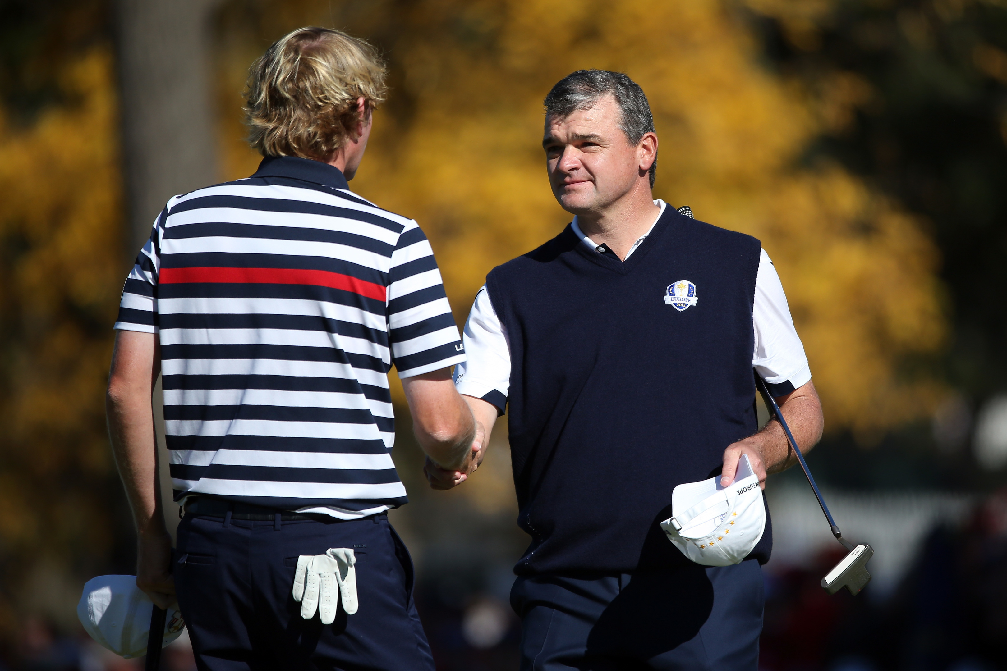 Paul Lawrie, right, shakes hands with Brandt Snedeker at Medinah.