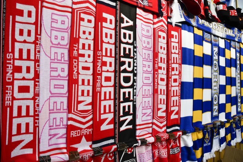 Morton and Aberdeen scarves are sold outside of the stadium