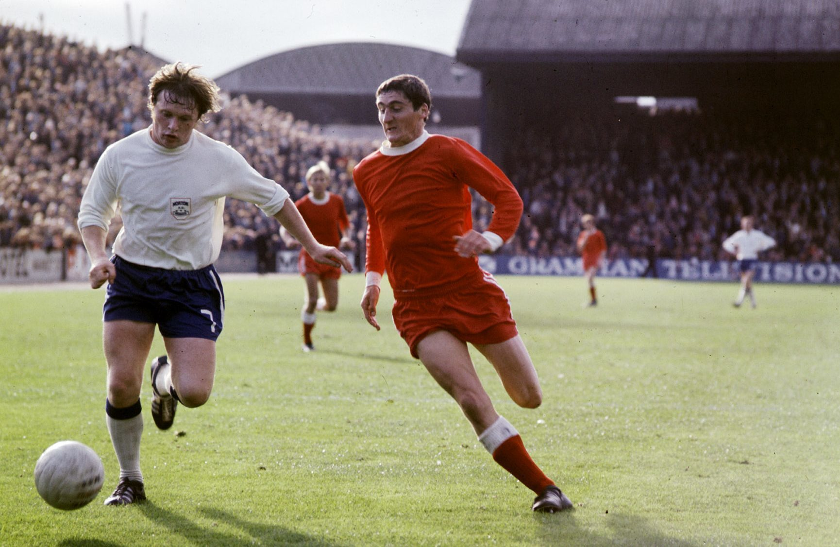 Joe Harper, then of Morton, in action against Aberdeen's Jim Hermiston.