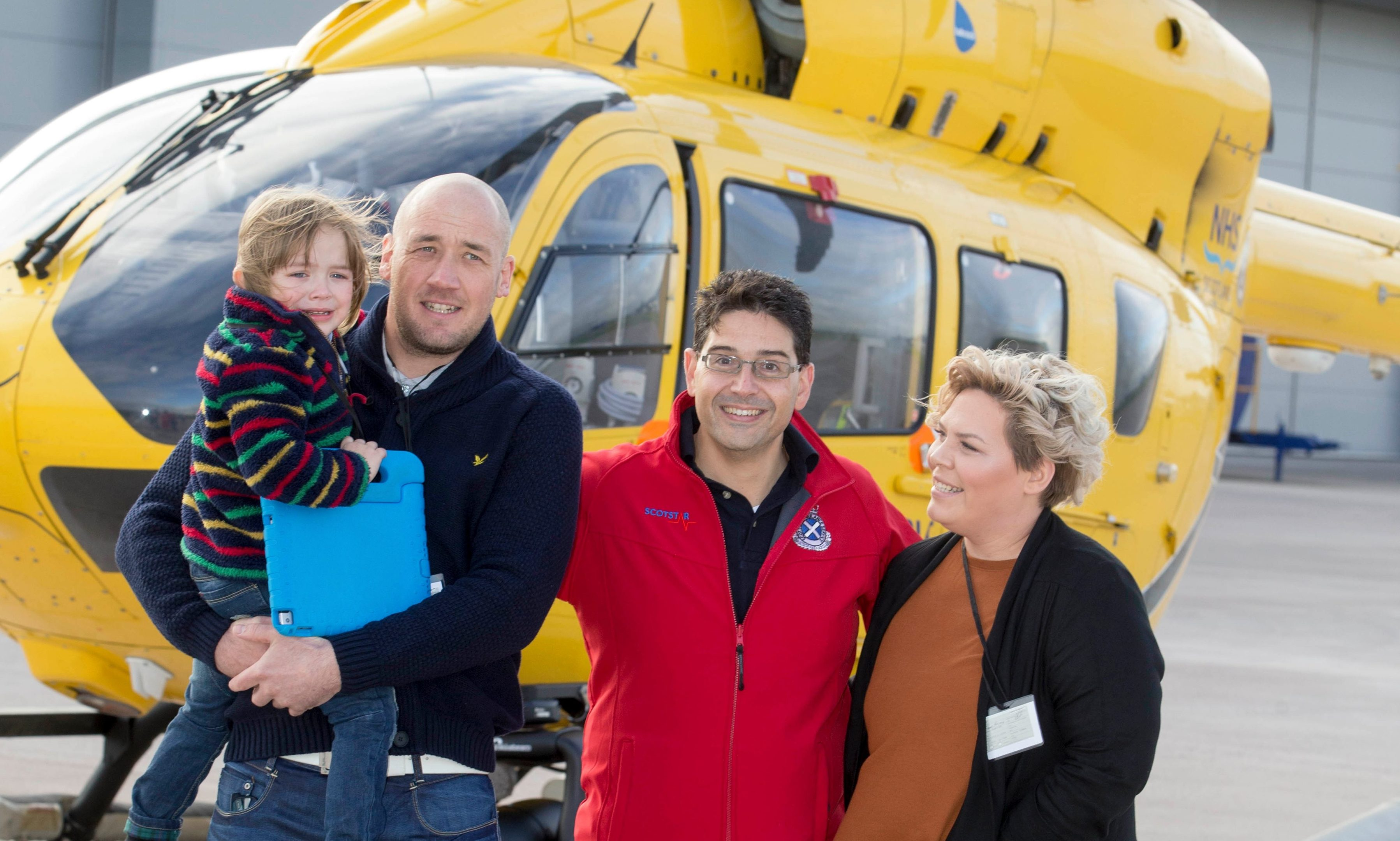 Four-year-old Mylo McLean with  dad Craig, consultant Edgar Brincat and mum Lianne.