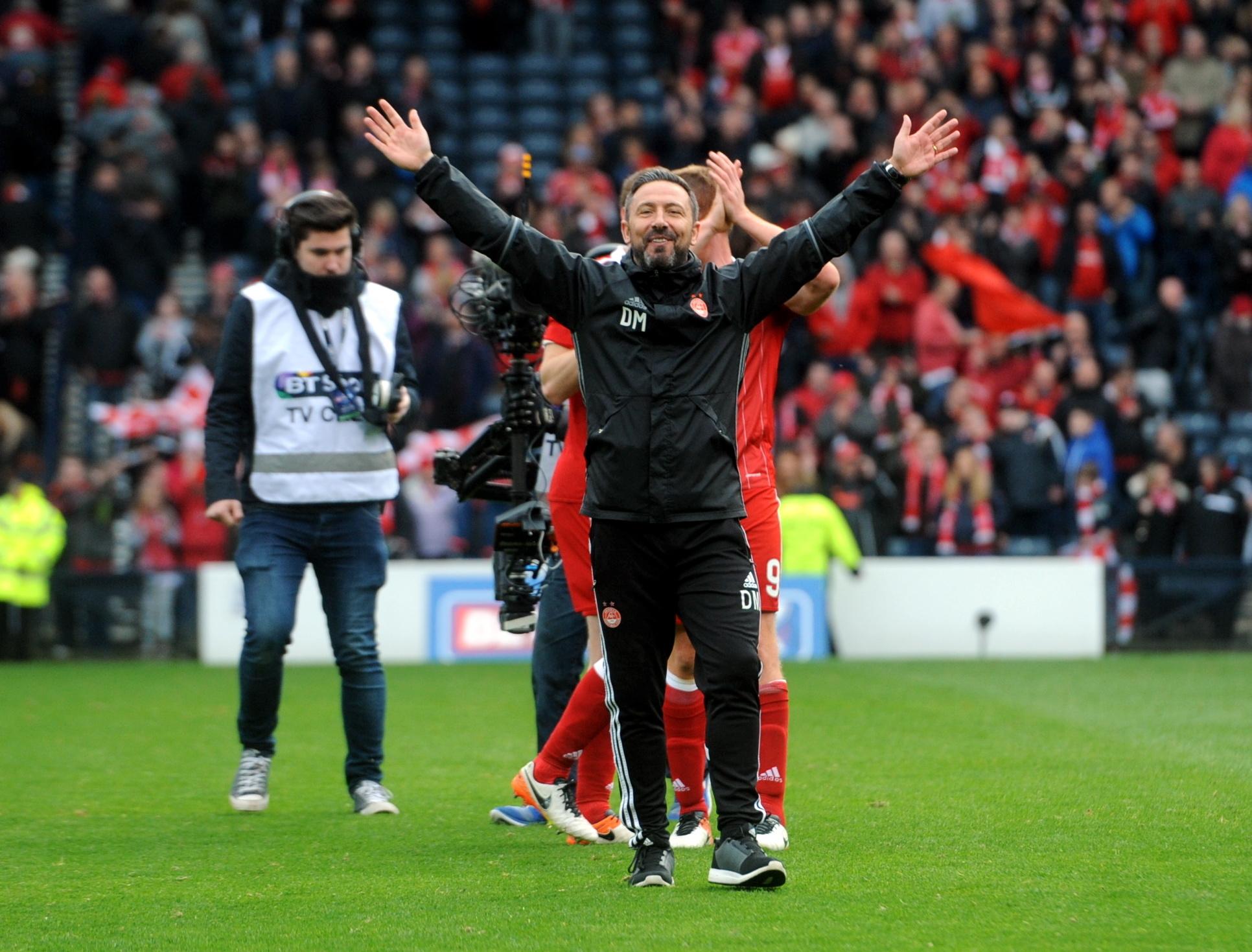 Derek McInnes celebrates at the final whistle.