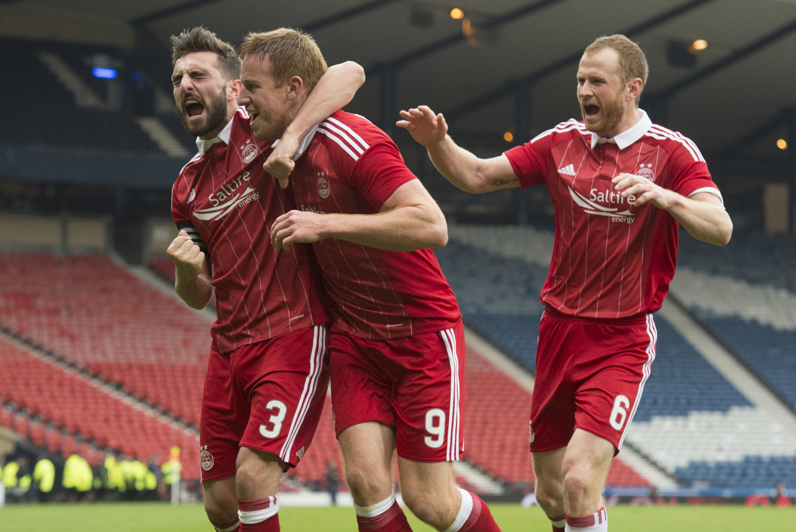 Mark Reynolds, right, and Graeme Shinnie, left, celebrate Adam Rooney's vital Betfred Cup goal against Morton at Hampden.