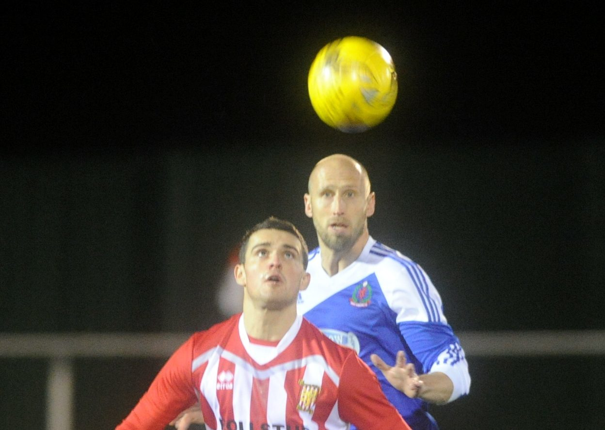 Cove's Alan Redford, right, and Formartine's Scott Barbour battle it out.
