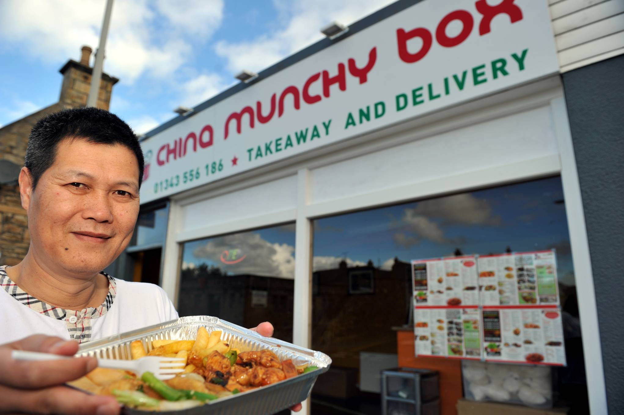 Tony Liang, outside his Chinese takeaway shop in North Street, Elgin.