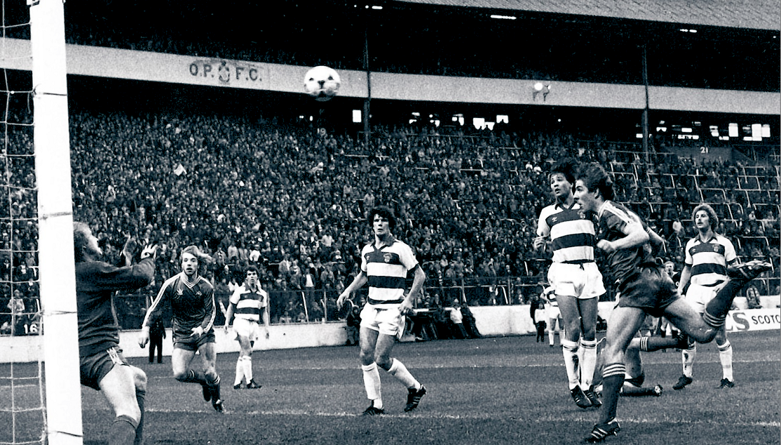 Mark McGhee heads over Roy Baines for the opening goal.
