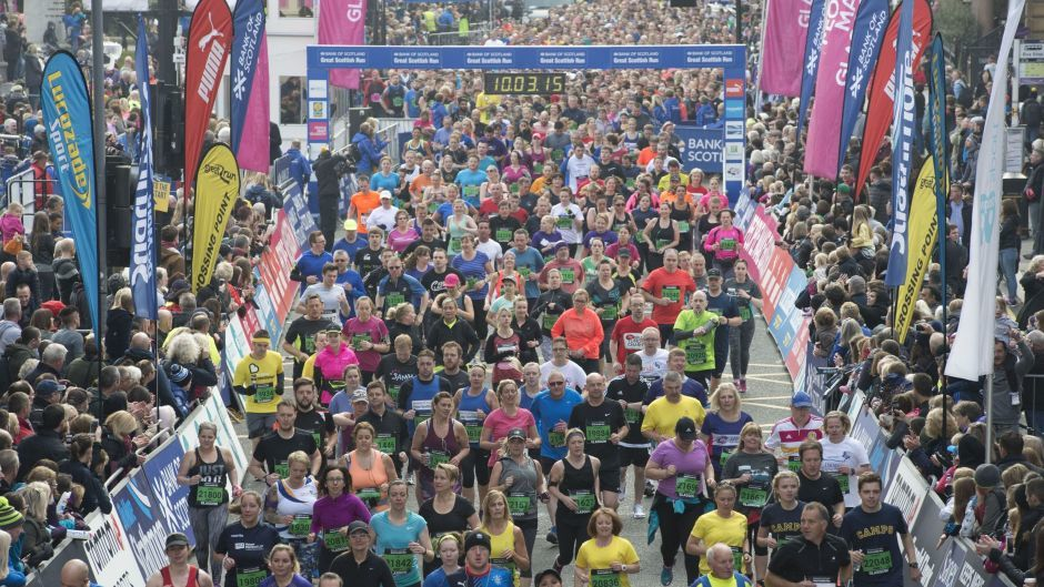Runners leave George Square at the start of the 10k race at the Great Scottish Run in Glasgow