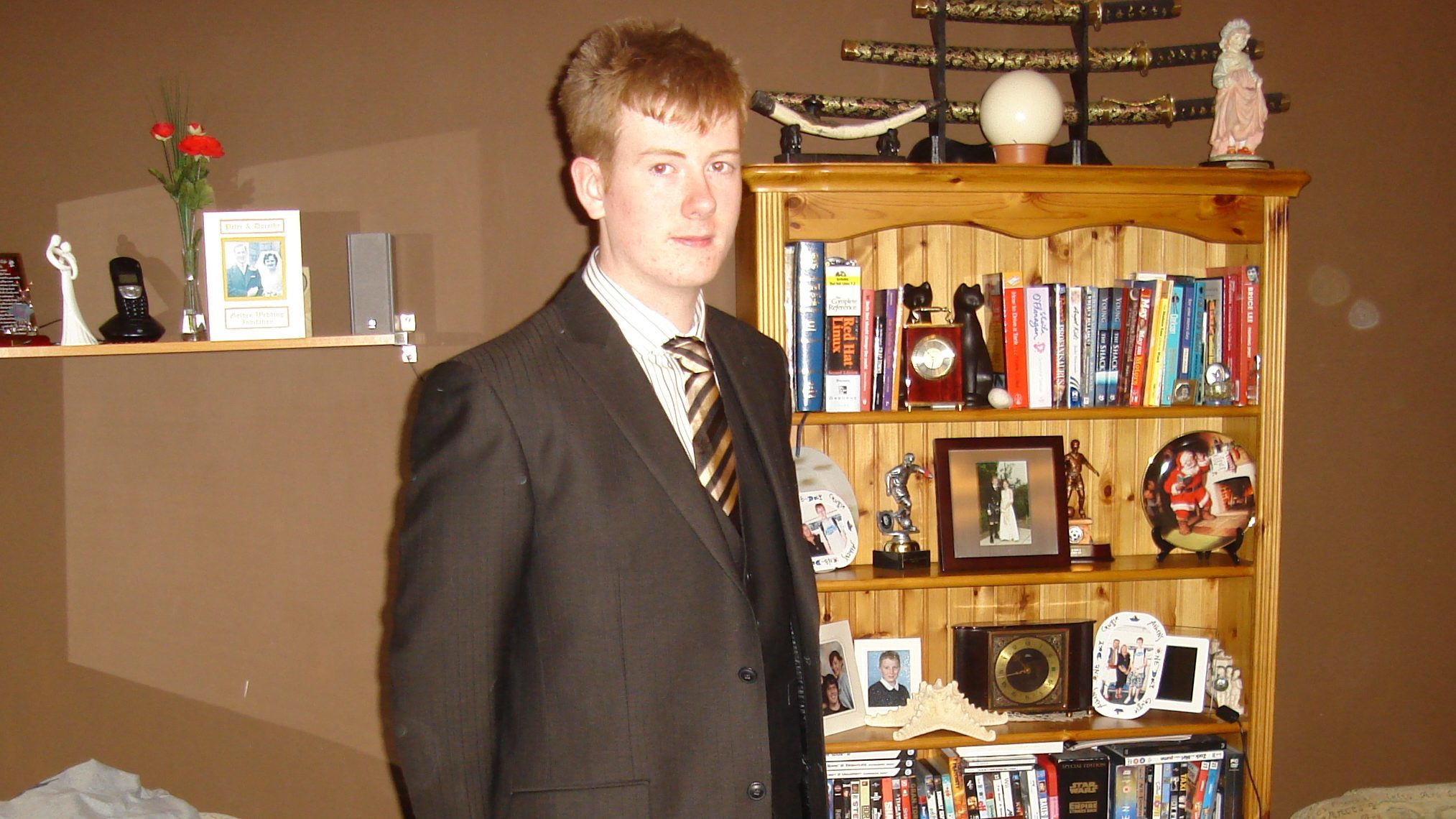 Mark Scott wearing a suit he got for his 19th.