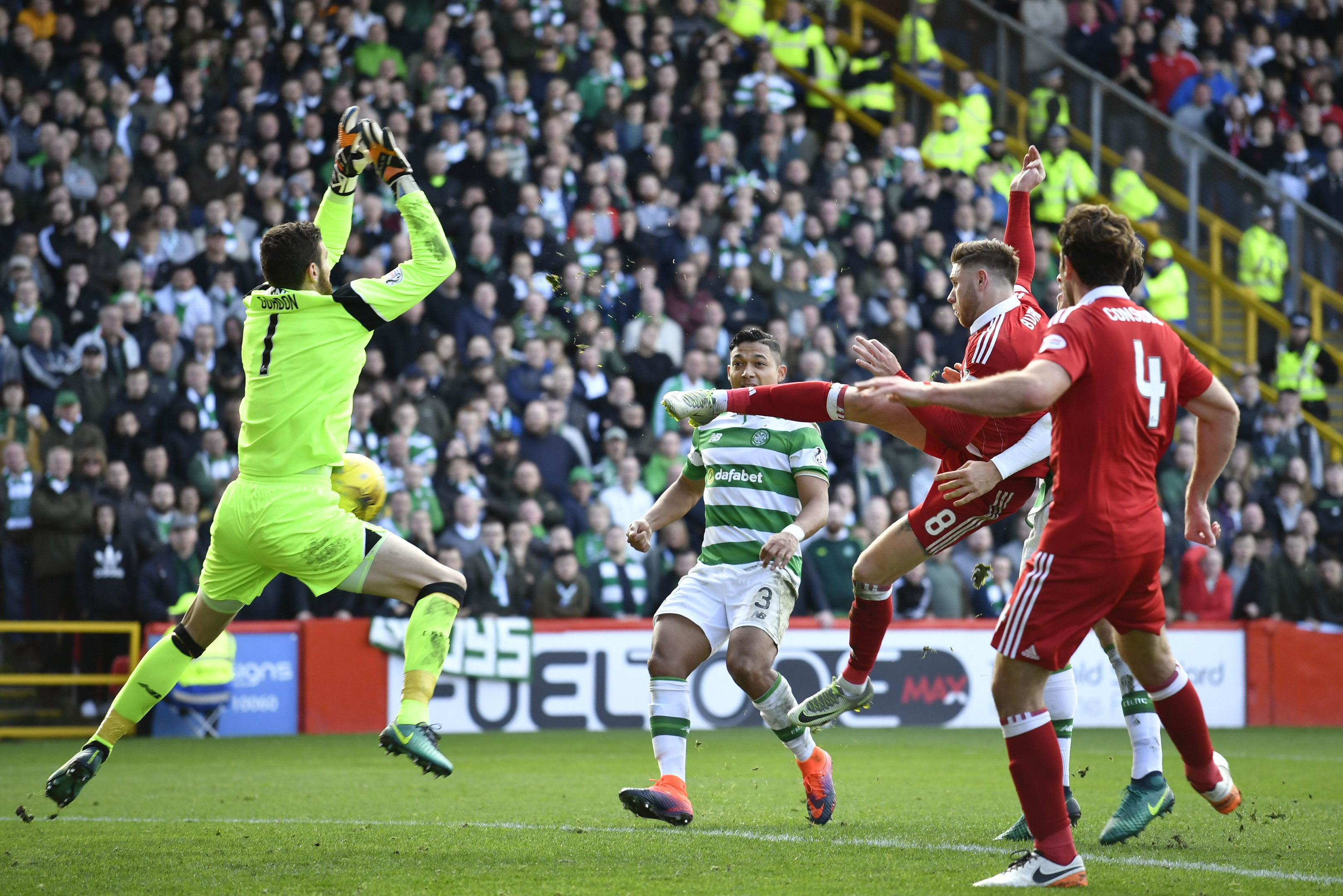 Aberdeen's Wes Burns, second from right, saw this effort saved by Craig Gordon.