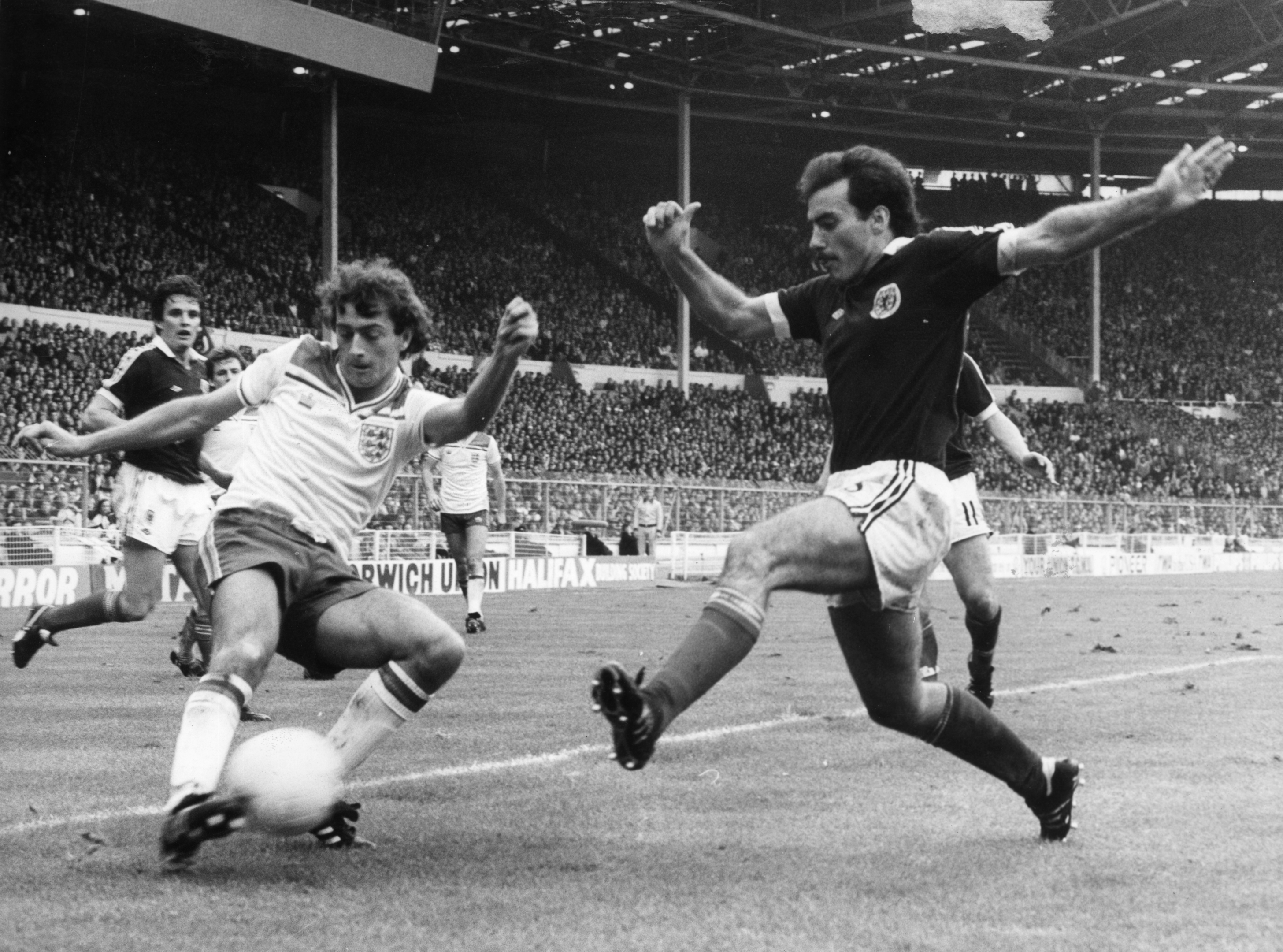 Scotland's Willie Miller, right, closes down England dangerman Trevor Francis at Wembley.