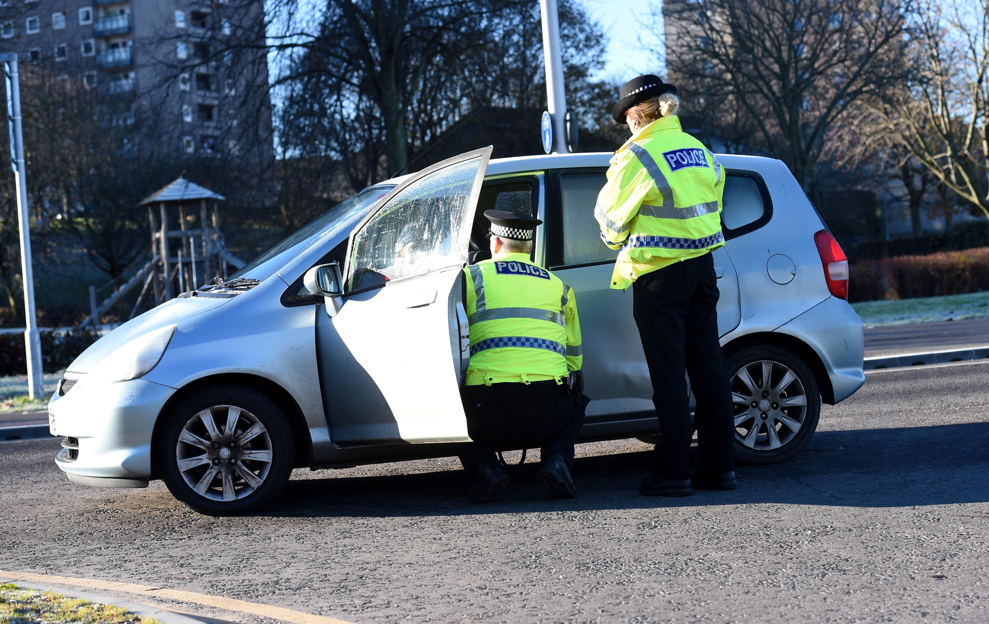 Pc Stuart Gordon and Pc Elizabeth Gibson talk to a driver.