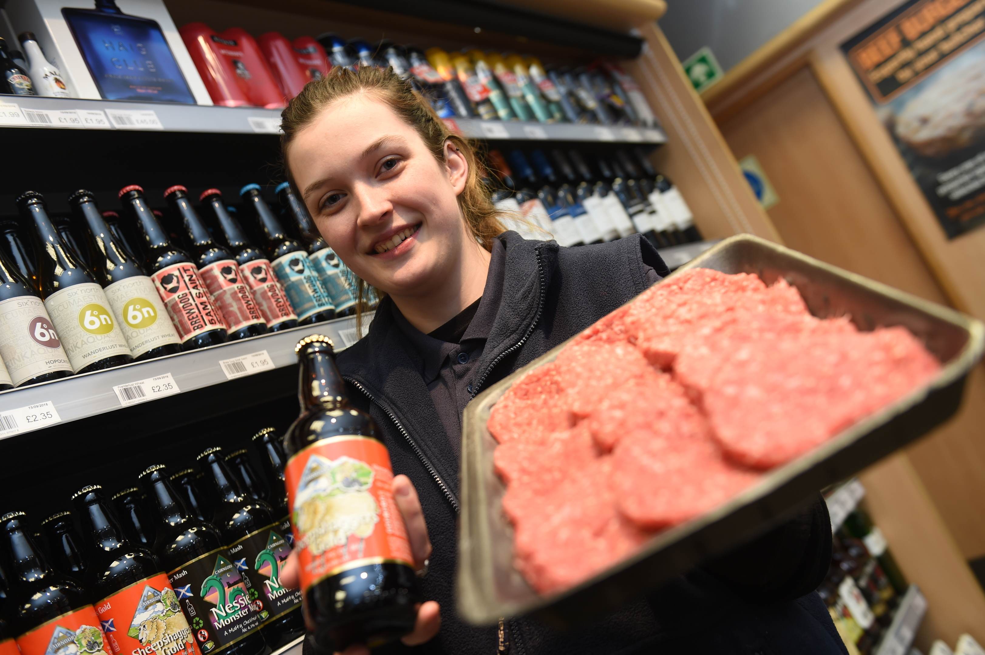 Erin Haig with the special Dons-themed burgers and the beer used to make them.