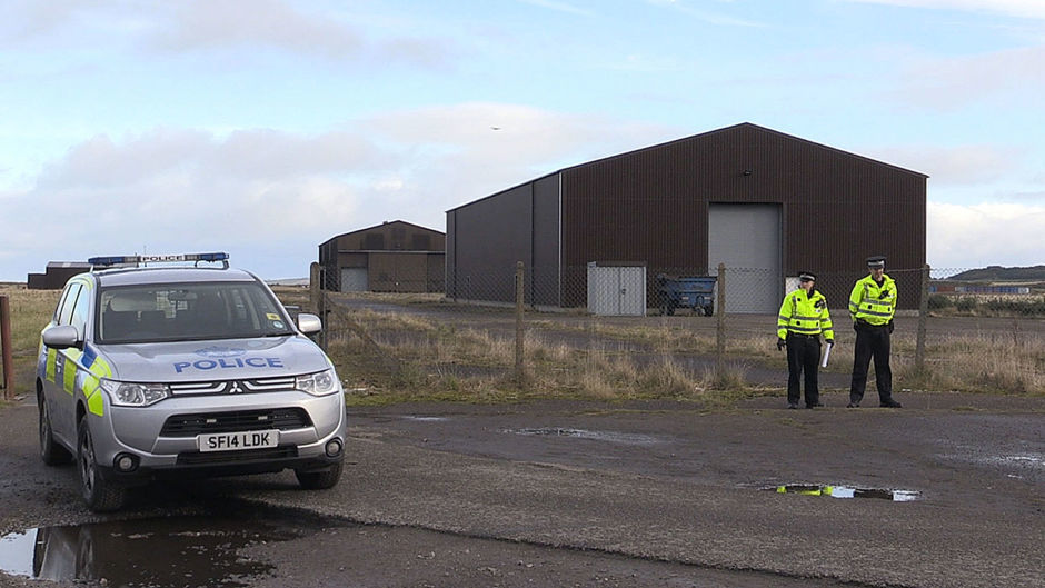 Police stand close to RAF Tain, north of Inverness, where a soldier was killed during a training exercise