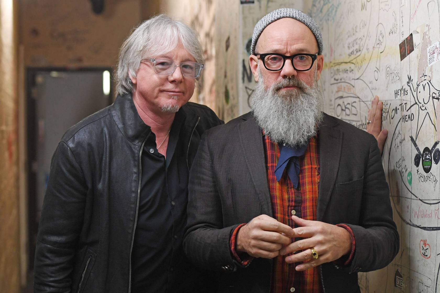 Mike Mills (left) and Michael Stipe of R.E.M pose following a Q&A at The Borderline in Soho, London, as they celebrate the 25th anniversary of their landmark album Out of Time.
