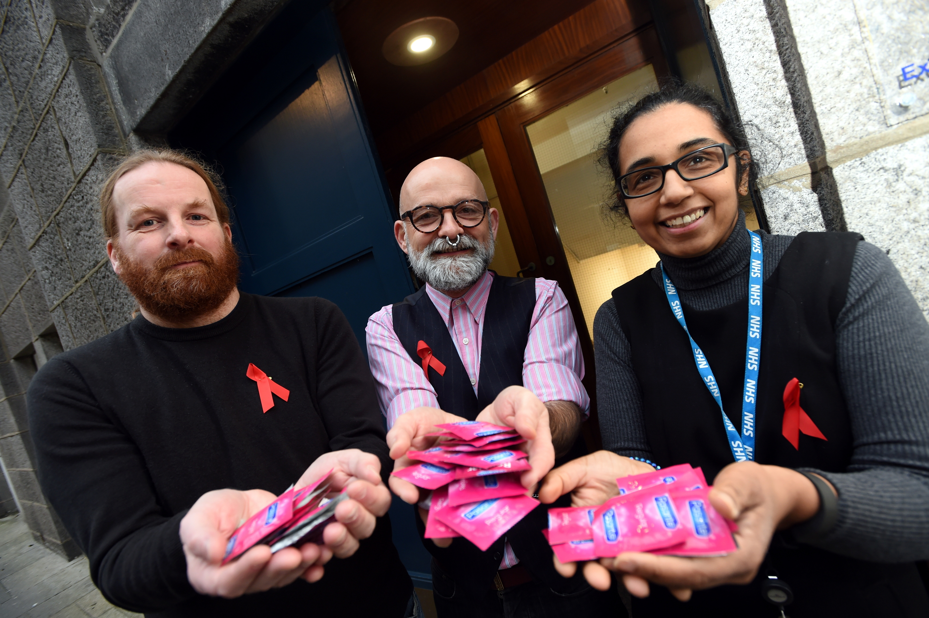 From left, Simon Pringle and Colin McKay of ADA and sexual health consultant Dr Ambreen Butt at the  Exchange Street Clinic.