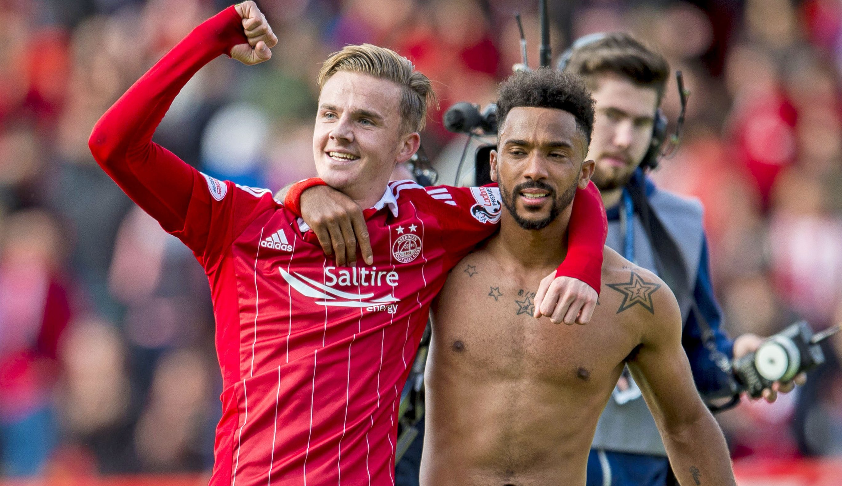 James Maddison celebrates with Dons team-mate Shay Logan after his  winning free-kick against Rangers.