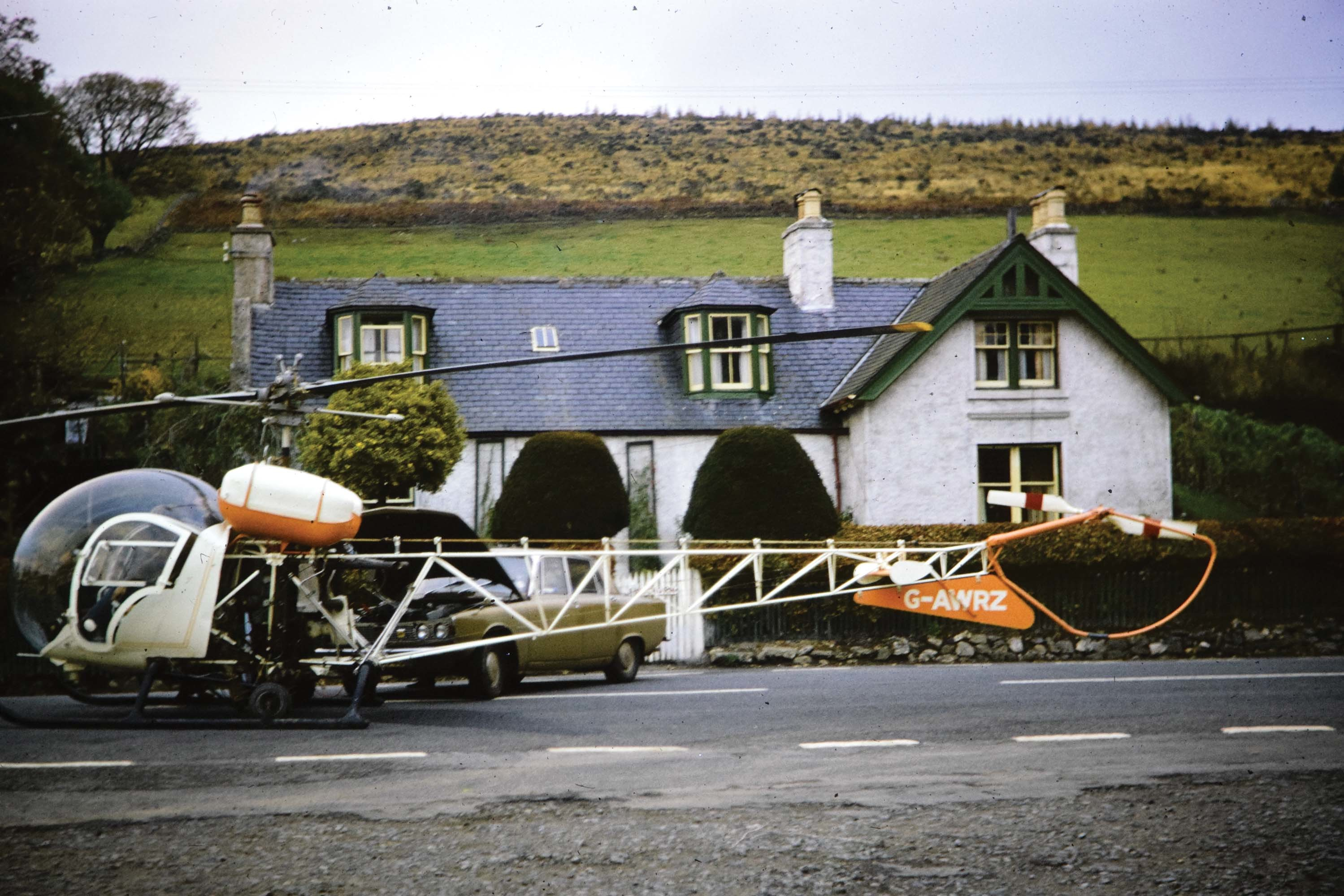 The Lonach Highland and Friendly Society are trying to trace the story behind this 40-year-old photograph of the helicopter.