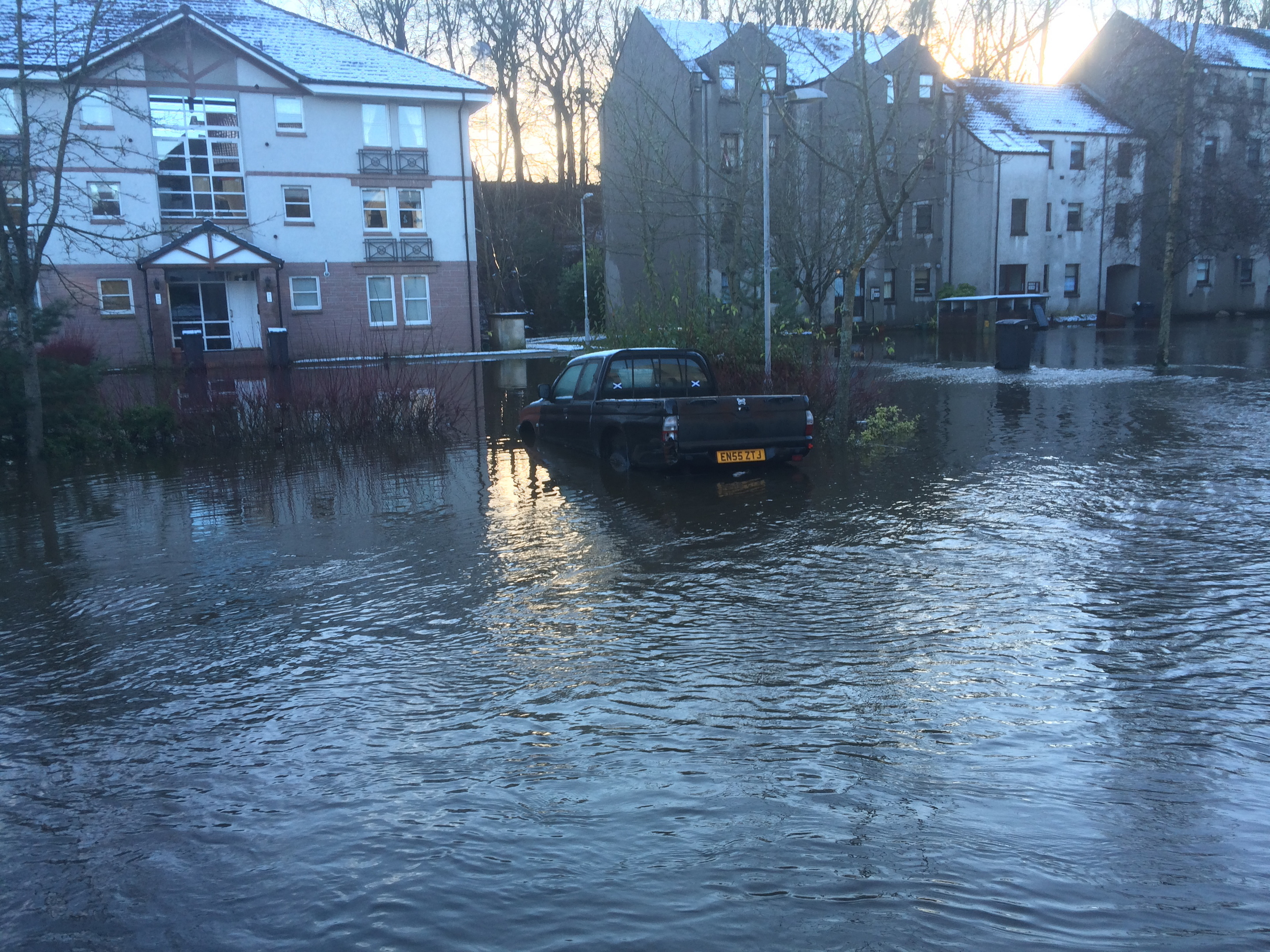 Flood water in the Millside area of Peterculter left this car stranded.